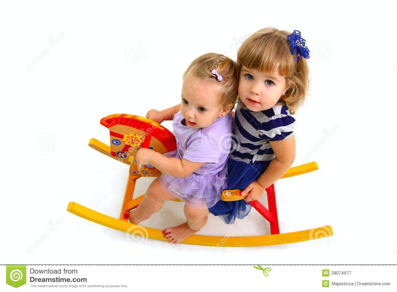 ... Free Stock Photography: Two cute babies riding on a toy wooden horse