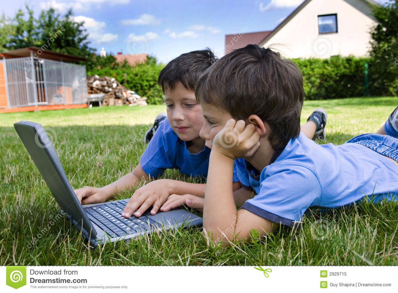 Two cute boy study on computer