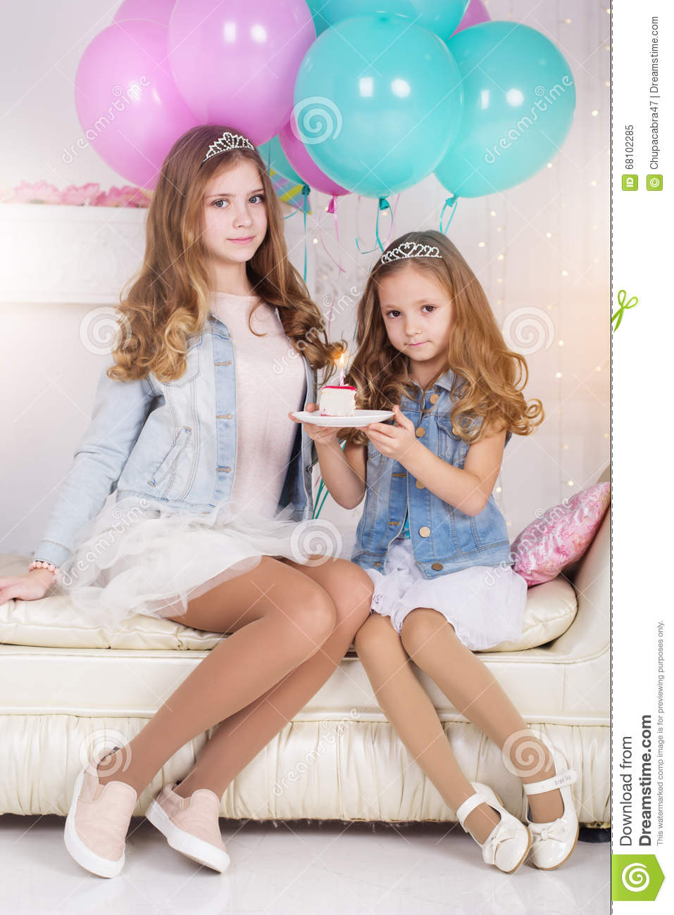 Two Cute Girls With Birthday Cake And Balloons Stock Photo