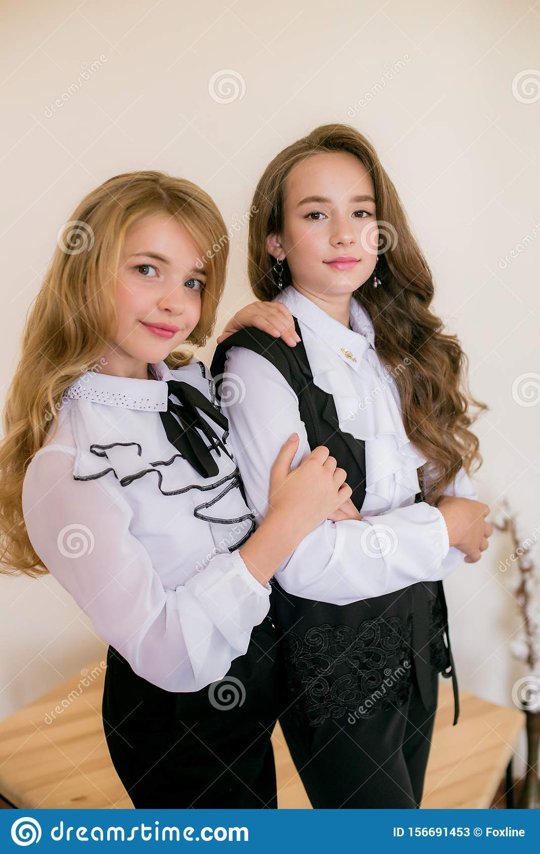 Two Cute Girls Schoolgirls With Long Curly Hair In