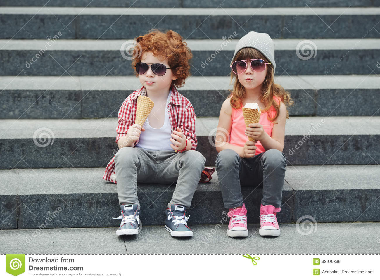 Two cute hipsters eating icecream