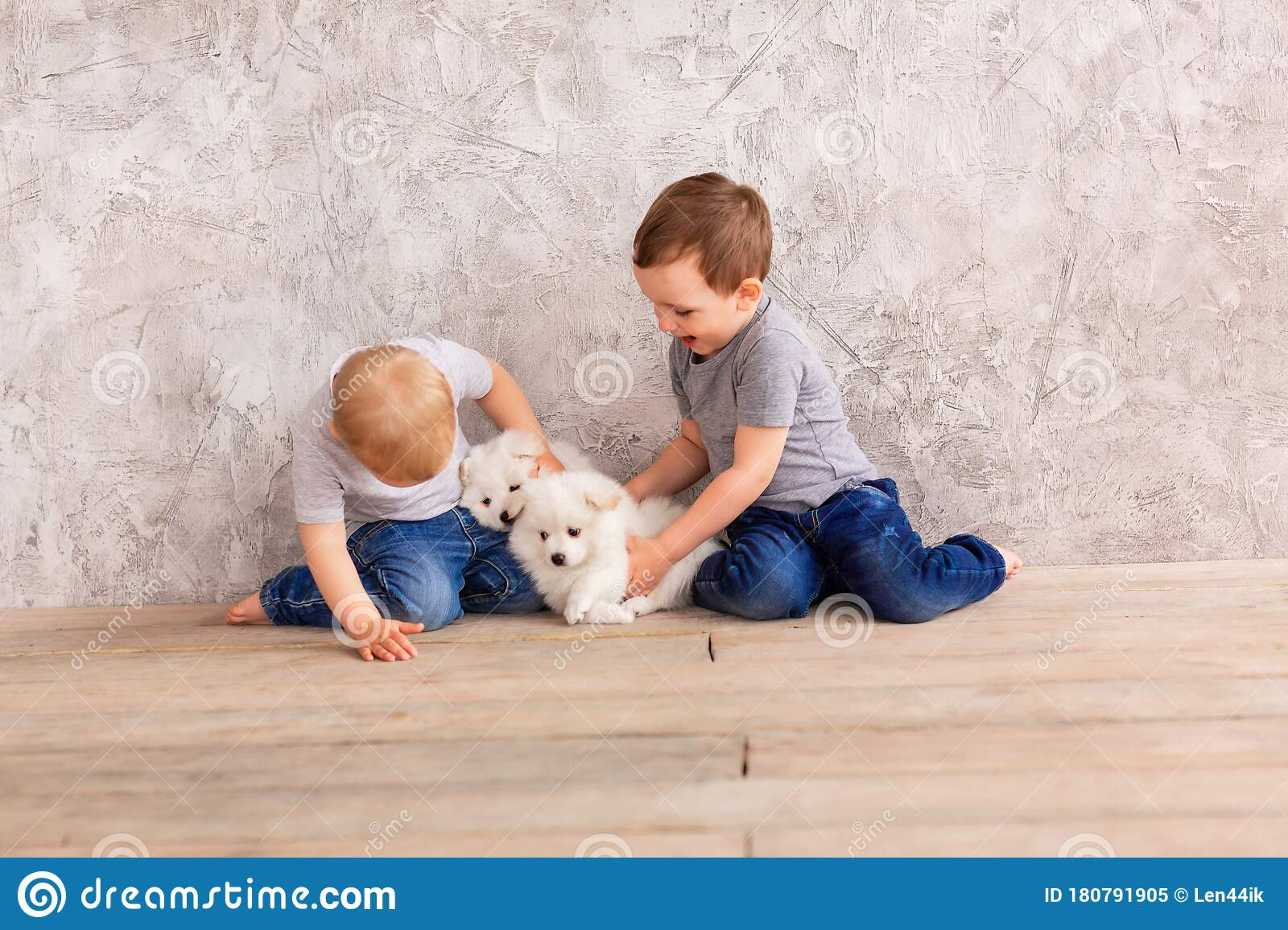 Two Cute Little Baby Boys Playing With Little White Puppies Stock Image Image Of Kiss Home 180791905