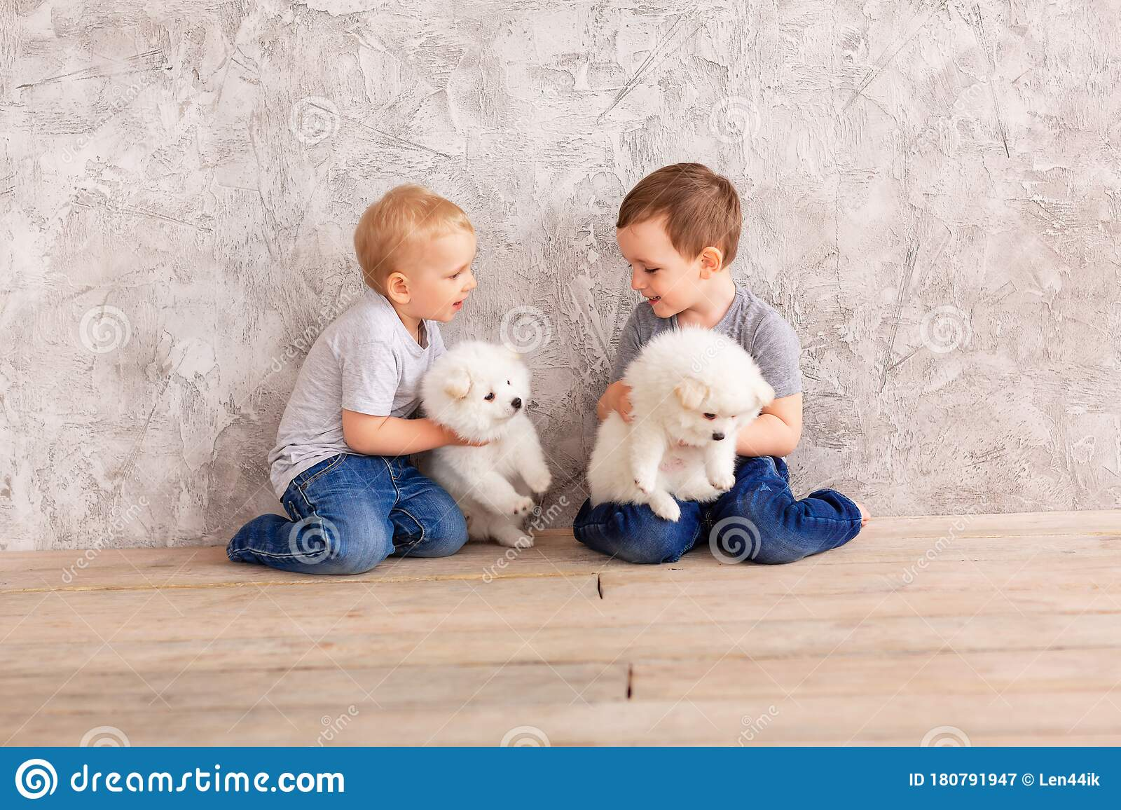 Two Cute Little Baby Boys Playing With Little White Puppies Stock Image Image Of Happy Baby 180791947