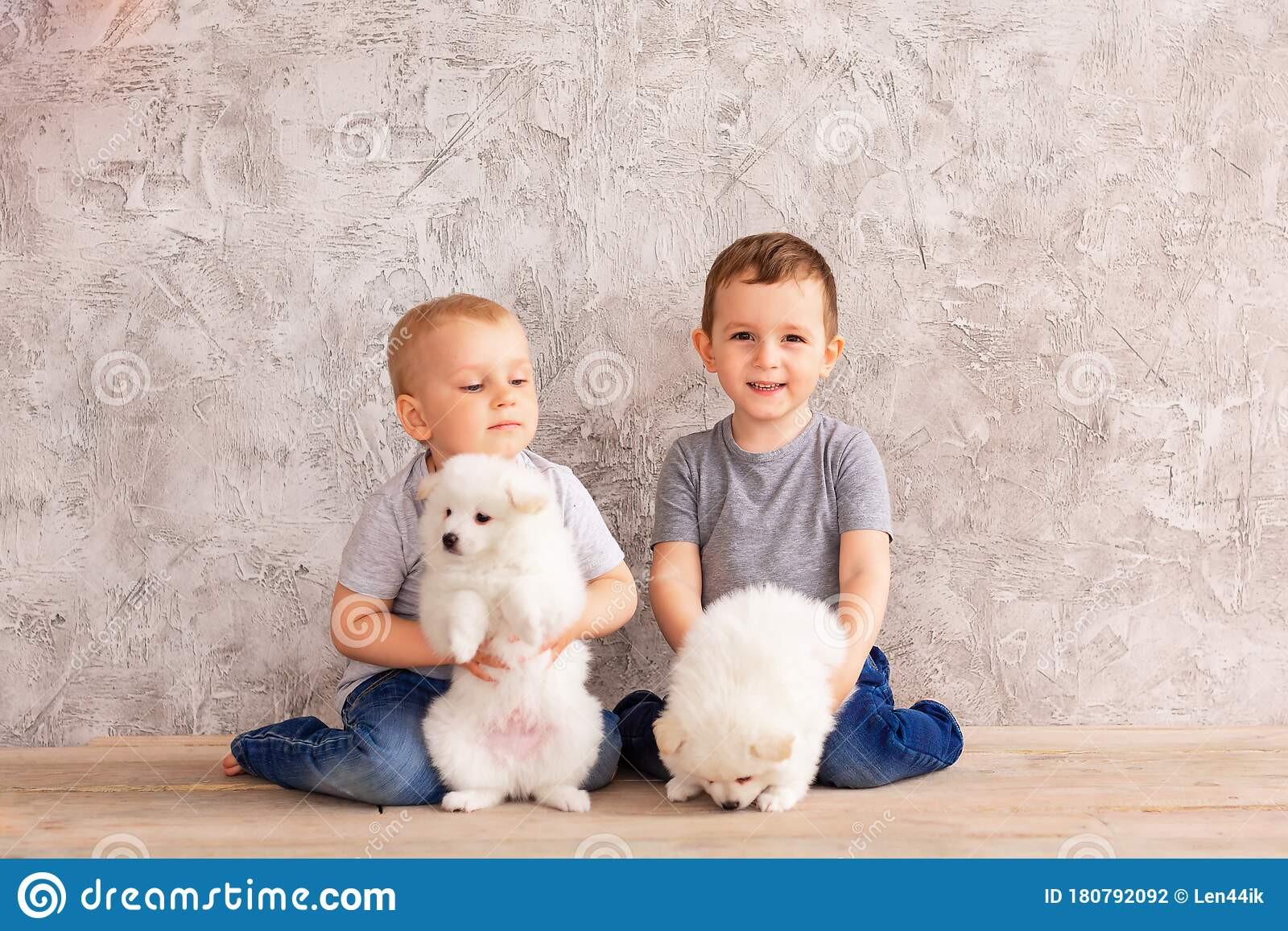 Young boy with two dogs stock photo. Image of kids, friend