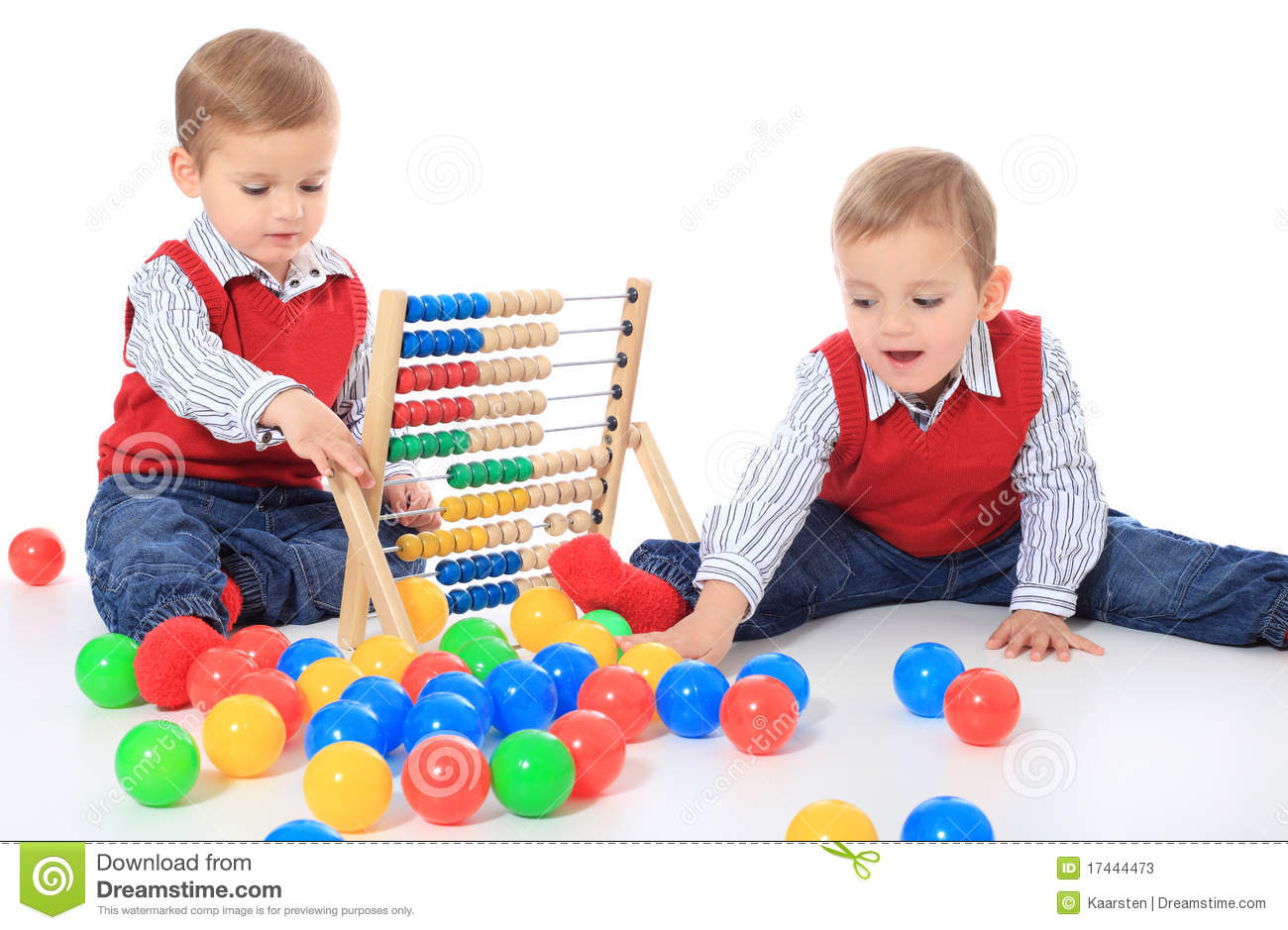 Little Boys Toys Border : Two cute little boys playing with toys stock image