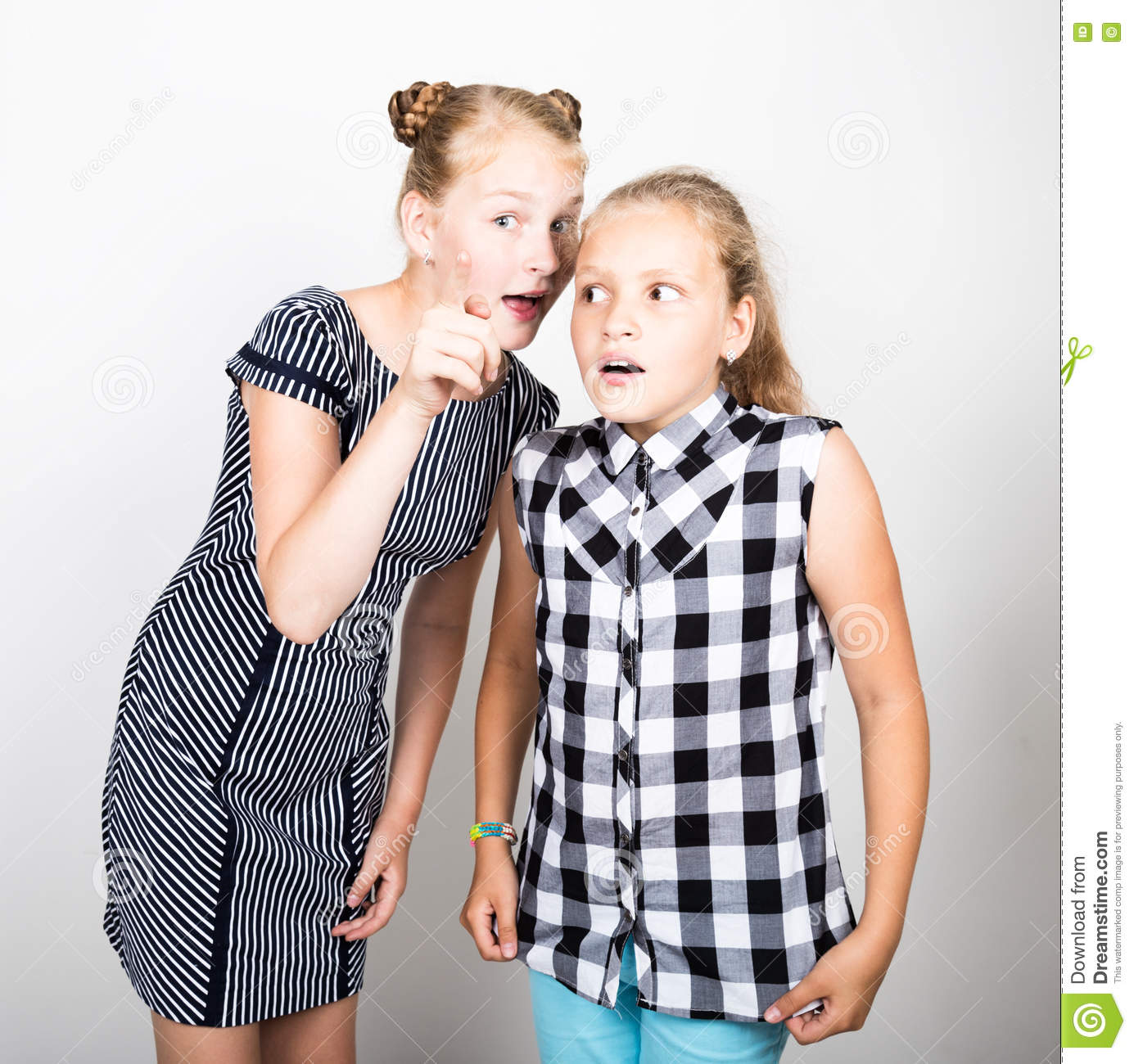 Two cute little girlfriend expressing different emotions. Funny kids. Best friends pamper and posing