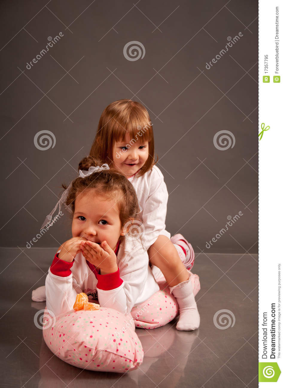 Two Cute Little Sisters In White Pajamas Royalty Free