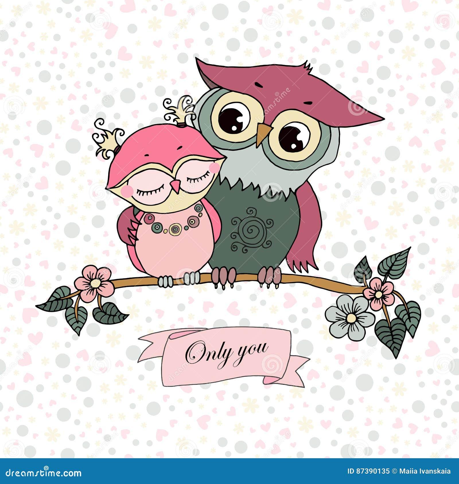 Two cute owls fallen in love