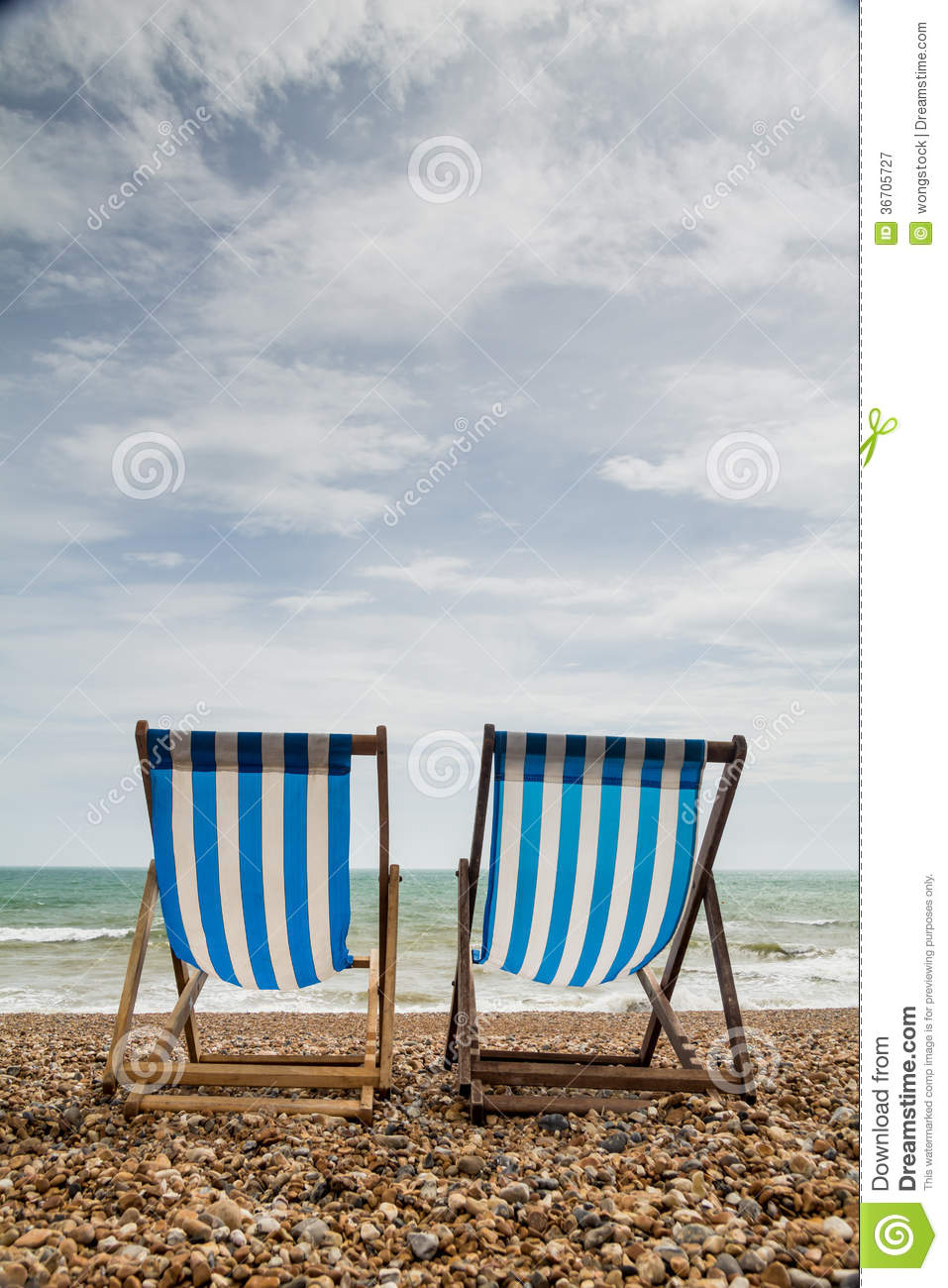 2 beach chairs on the beach - Two Deck Chairs On Brighton Beach England