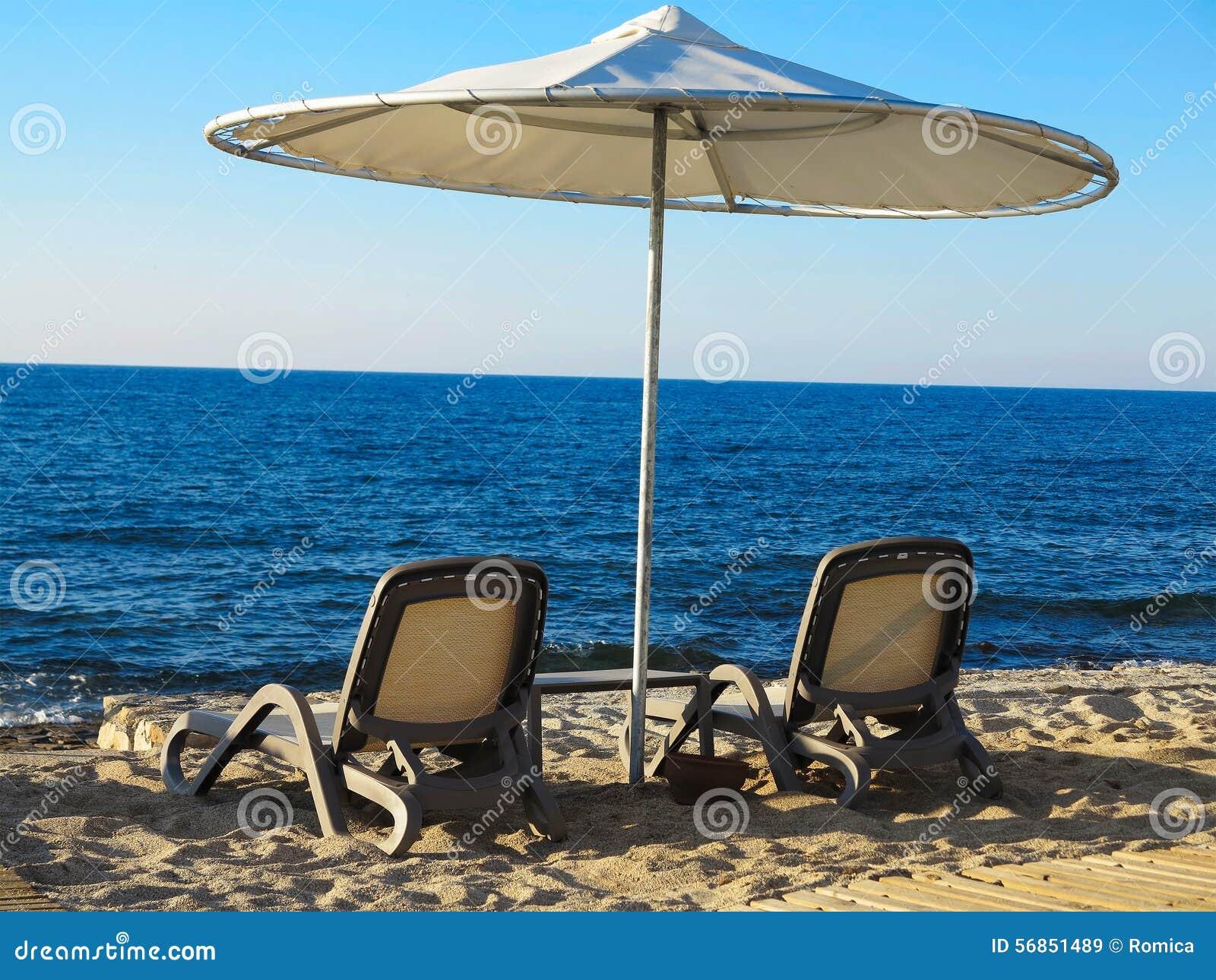 La Sdraia O La Sdraio.Two Deckchairs And Umbrella On Blue Sea Sand Beach Stock Image