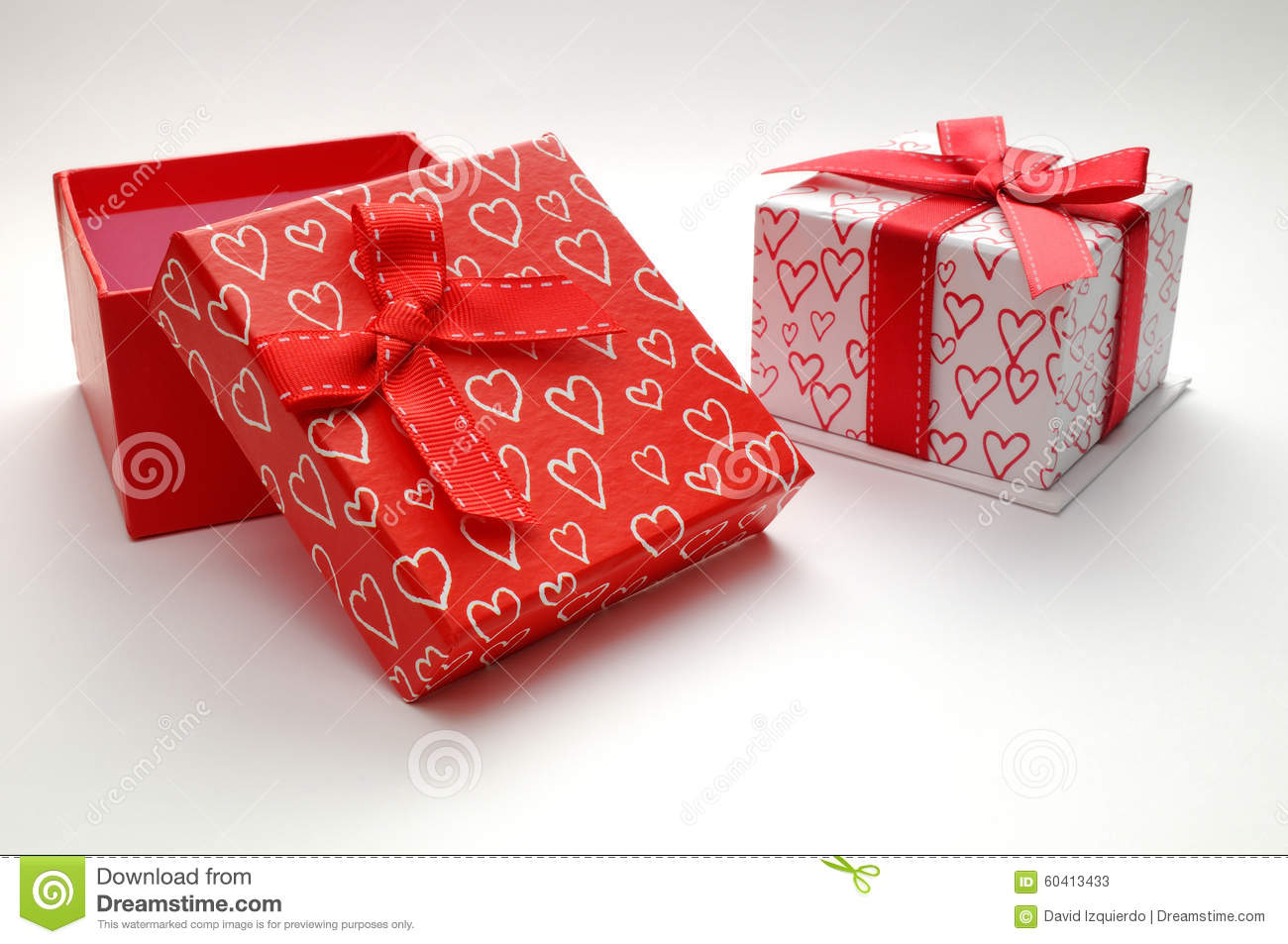 Two decorative gift boxes with hearts printed isolated