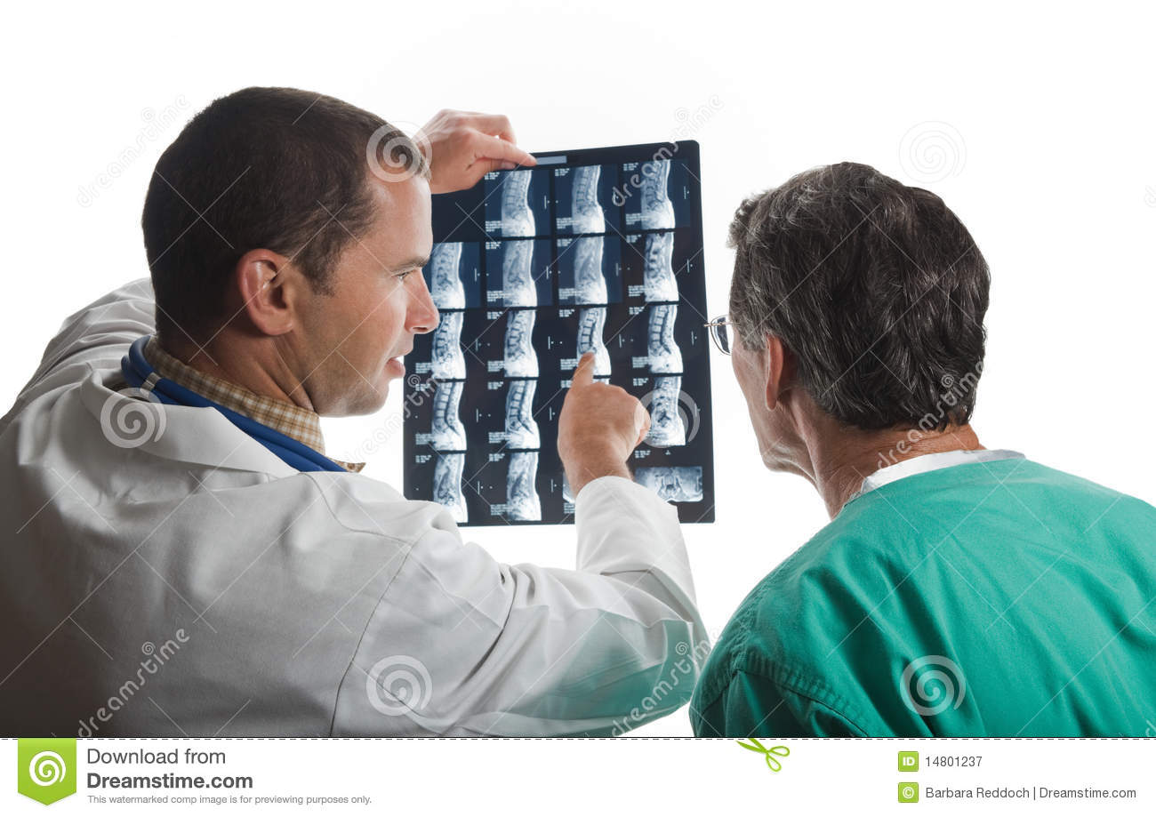 Two Doctors Examining Patient s Spinal Film Scans