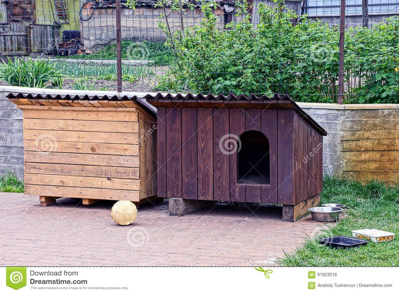 Two dog house booths in the yard
