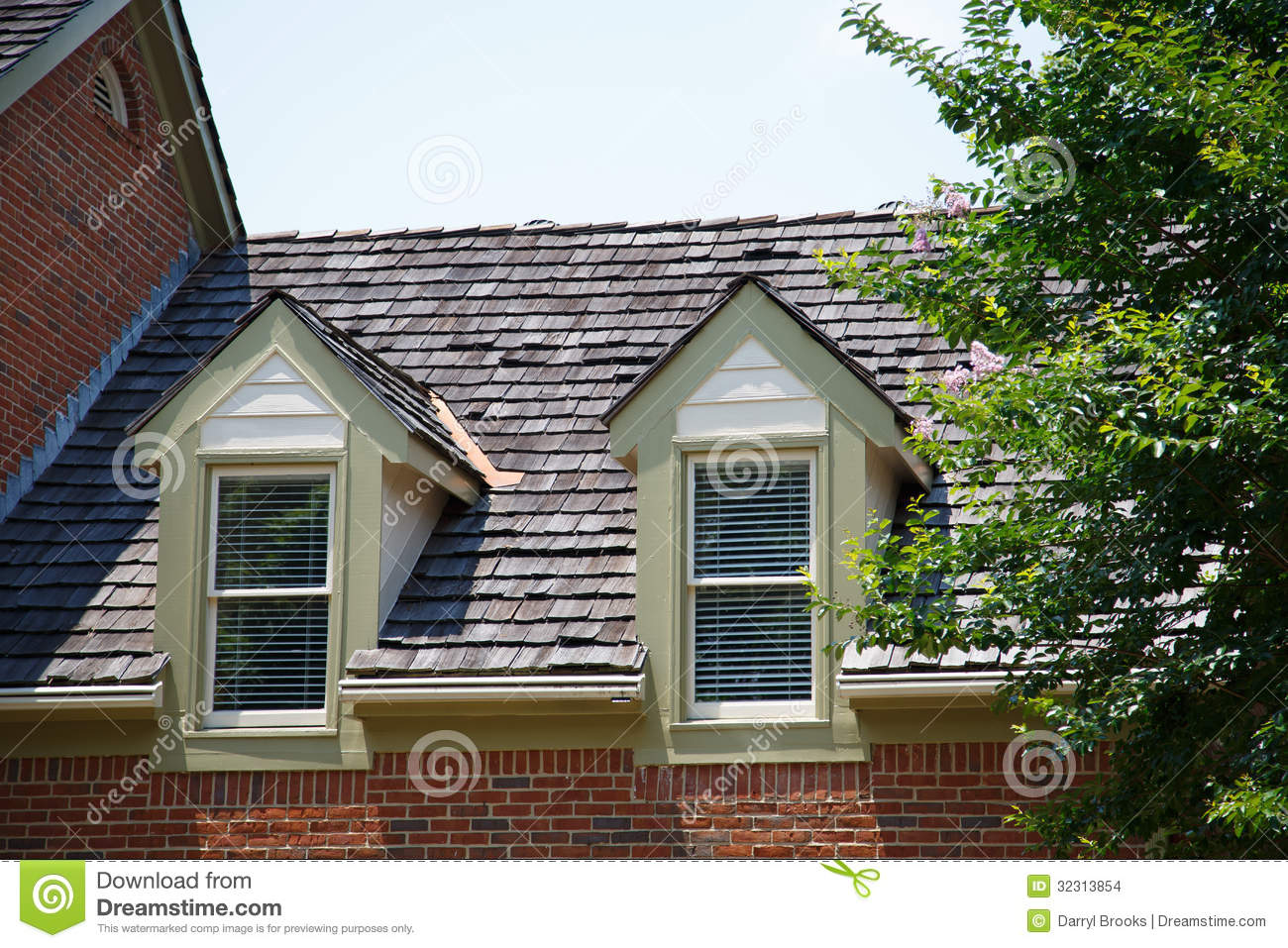 Two Dormers On Brick Homes With Wood Shingles Stock Photo