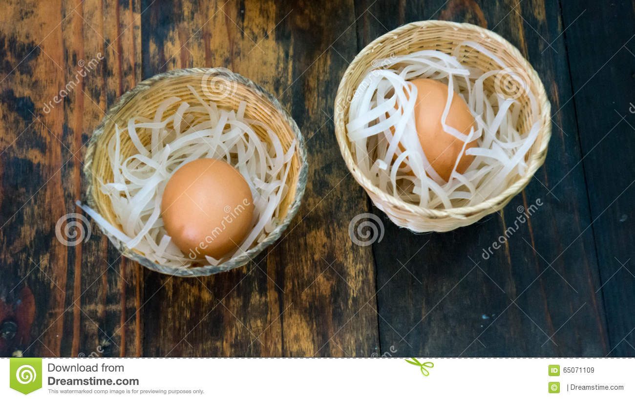 Two eggs in small baskets