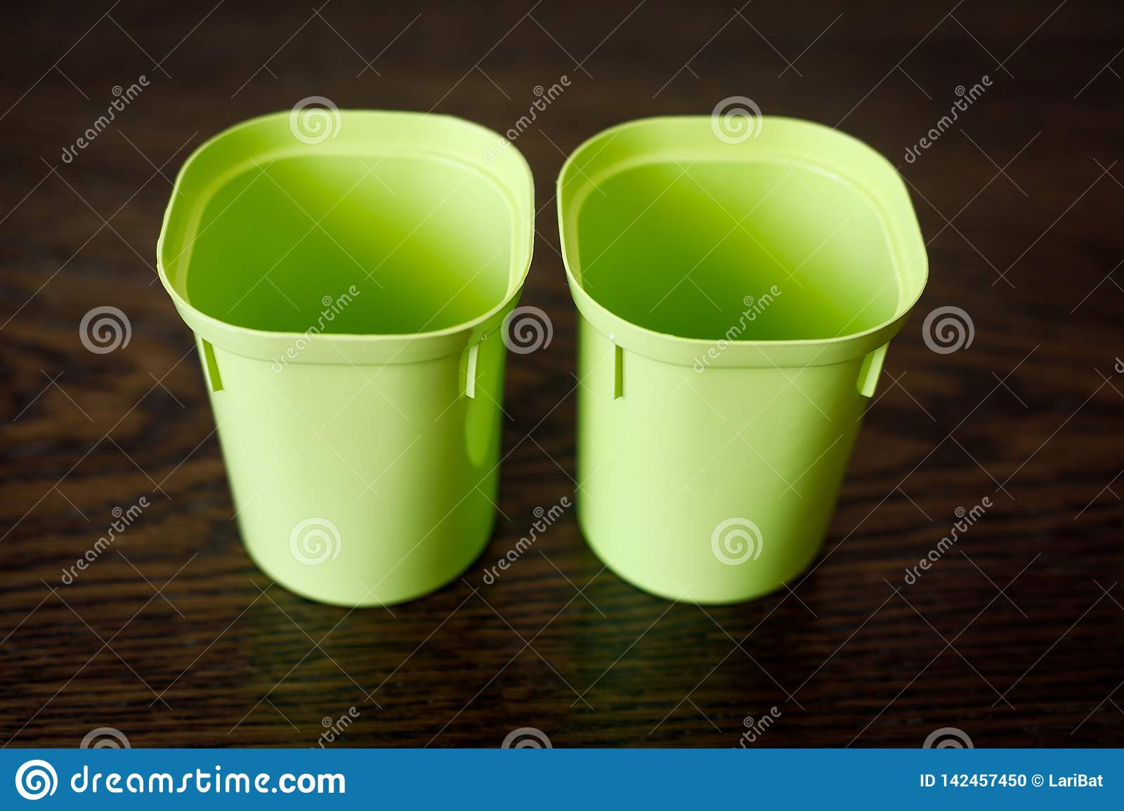 Two empty plastic cups for seedlings. Floriculture items