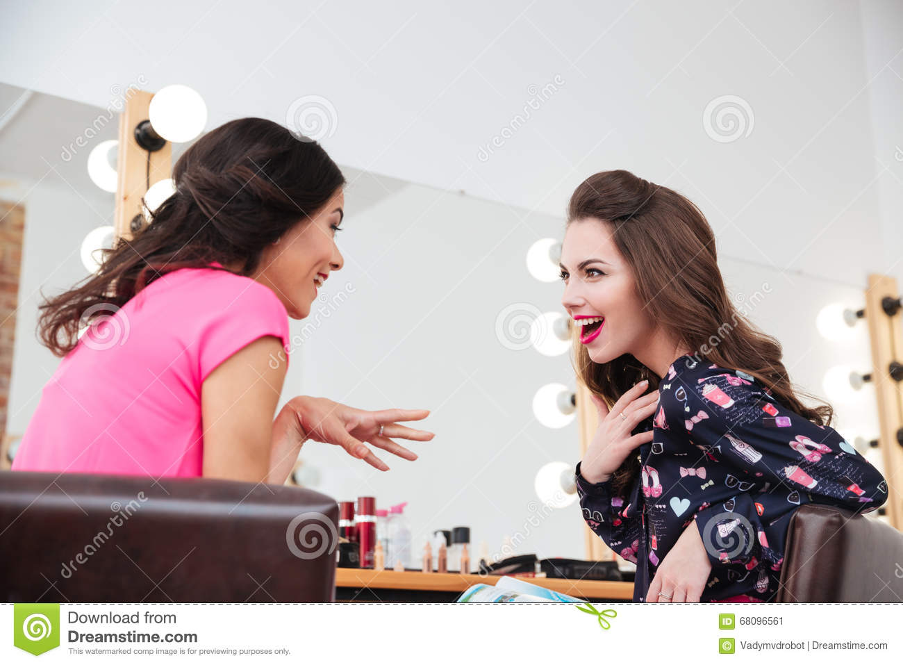 Two excited wondered young women talking in beauty salon - Nearest beauty salon ...