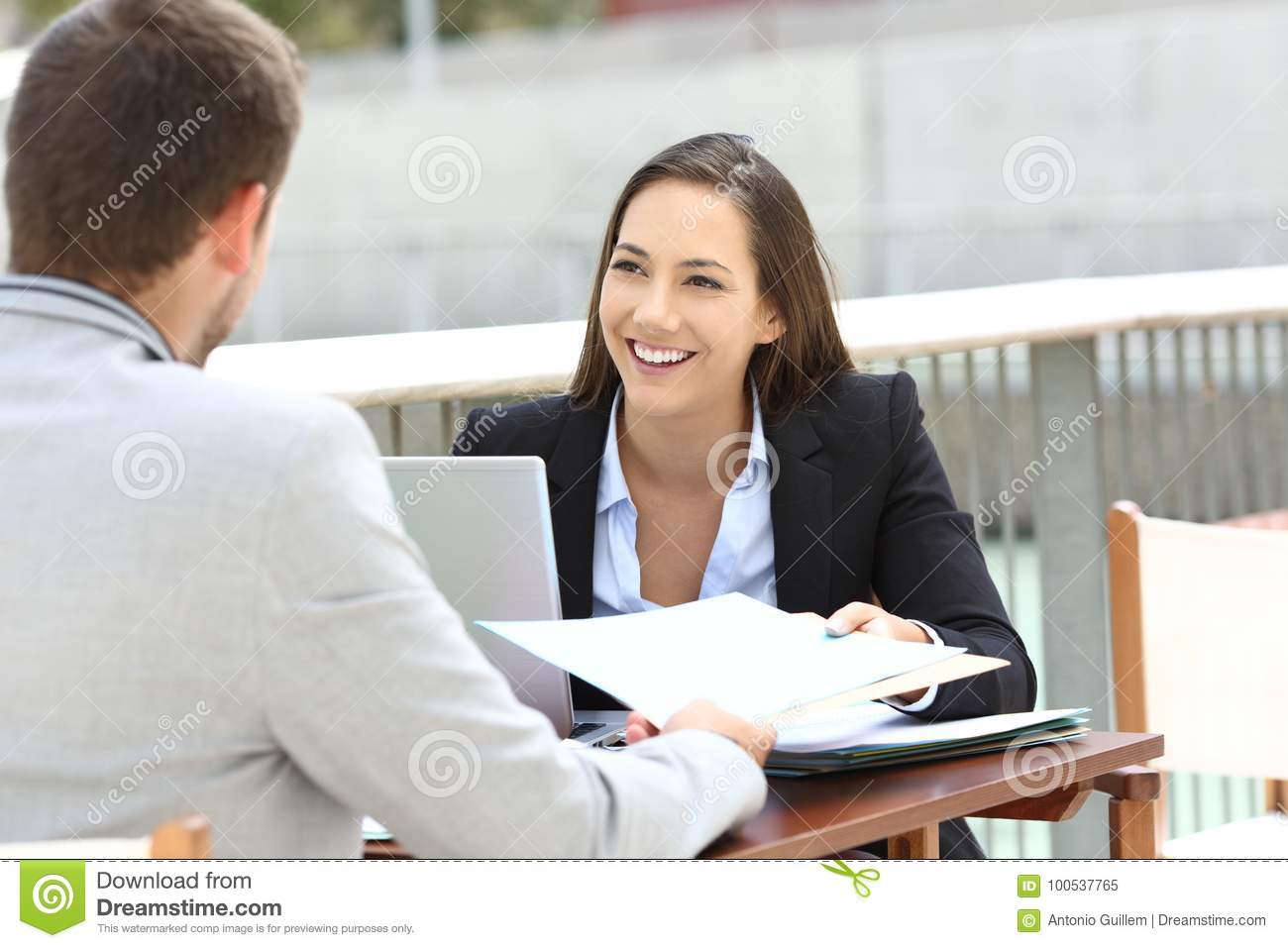Two executives working sharing informs