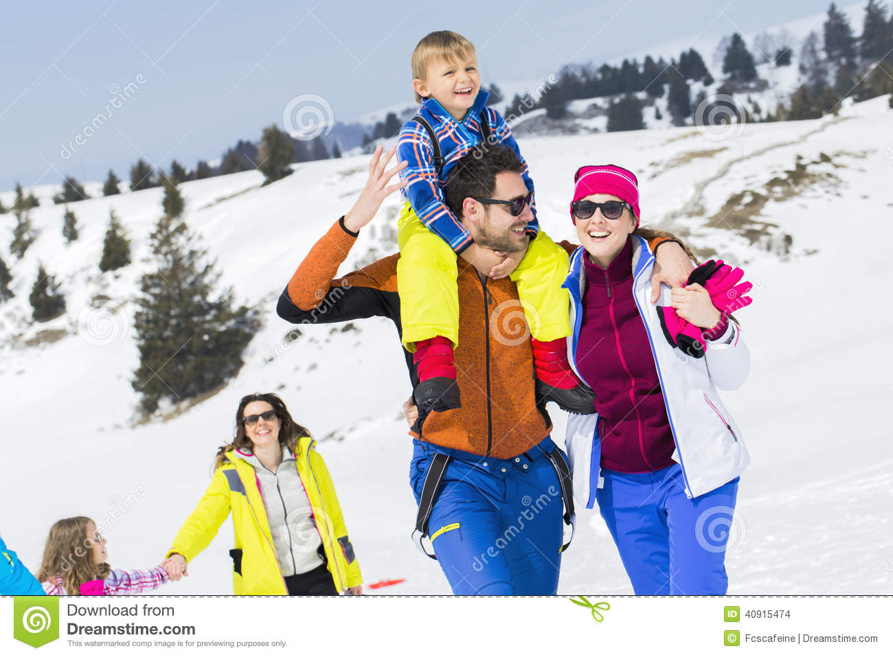 Two families with children walking in the snow