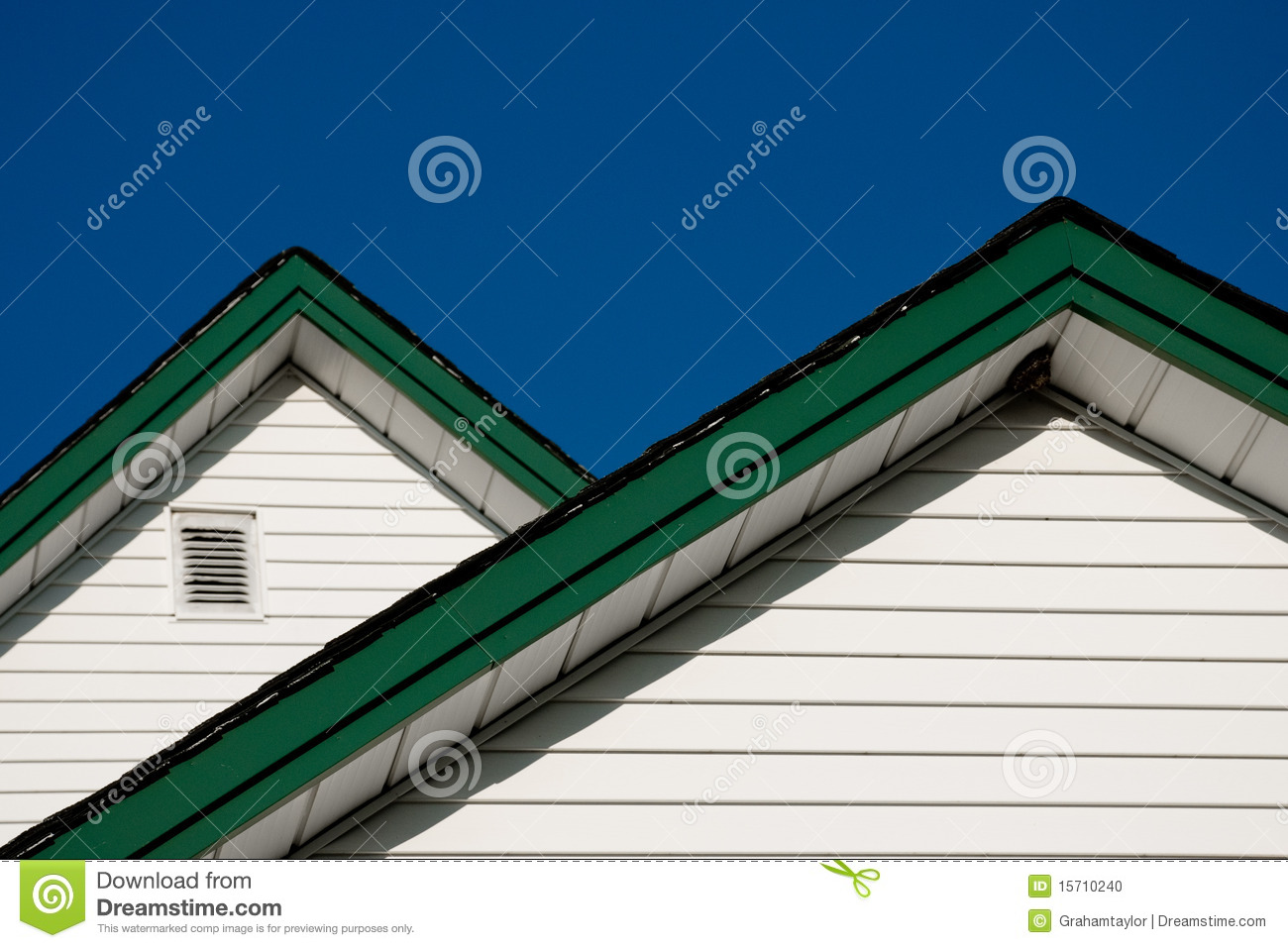 two farmhouse roof peaks against a blue sky stock photo. Black Bedroom Furniture Sets. Home Design Ideas