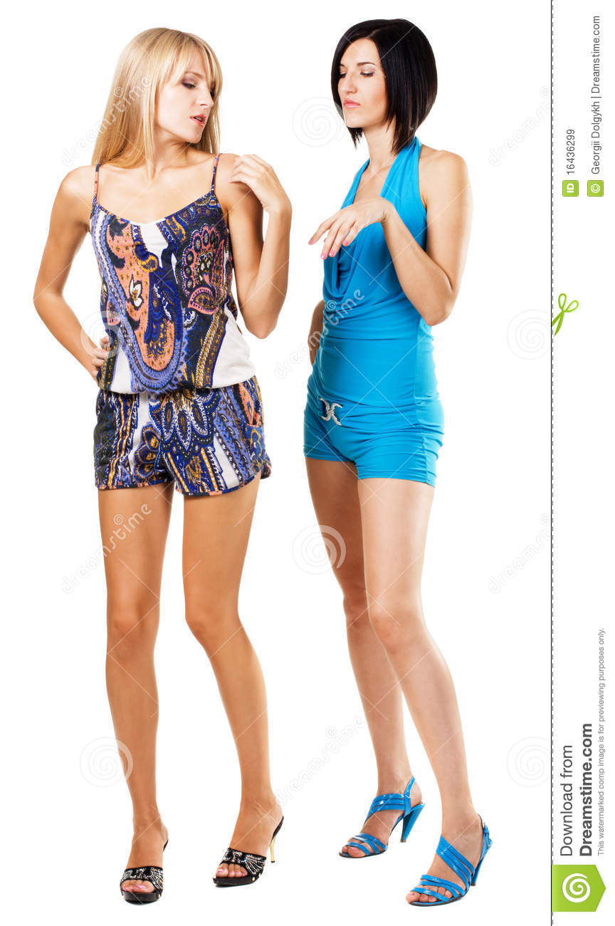 Two fashionable women in colorful clothing, white background