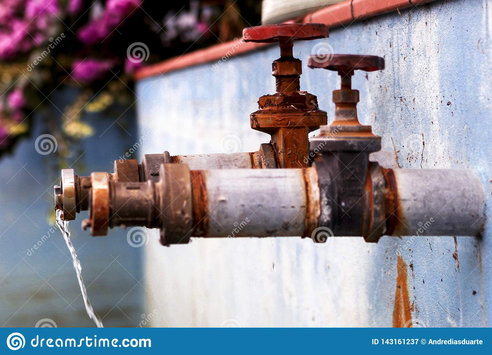 Two faucets with water running