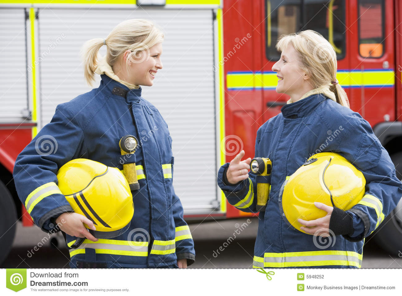 Two Female Firefighters By A Fire Engine Stock Photography - Image ...