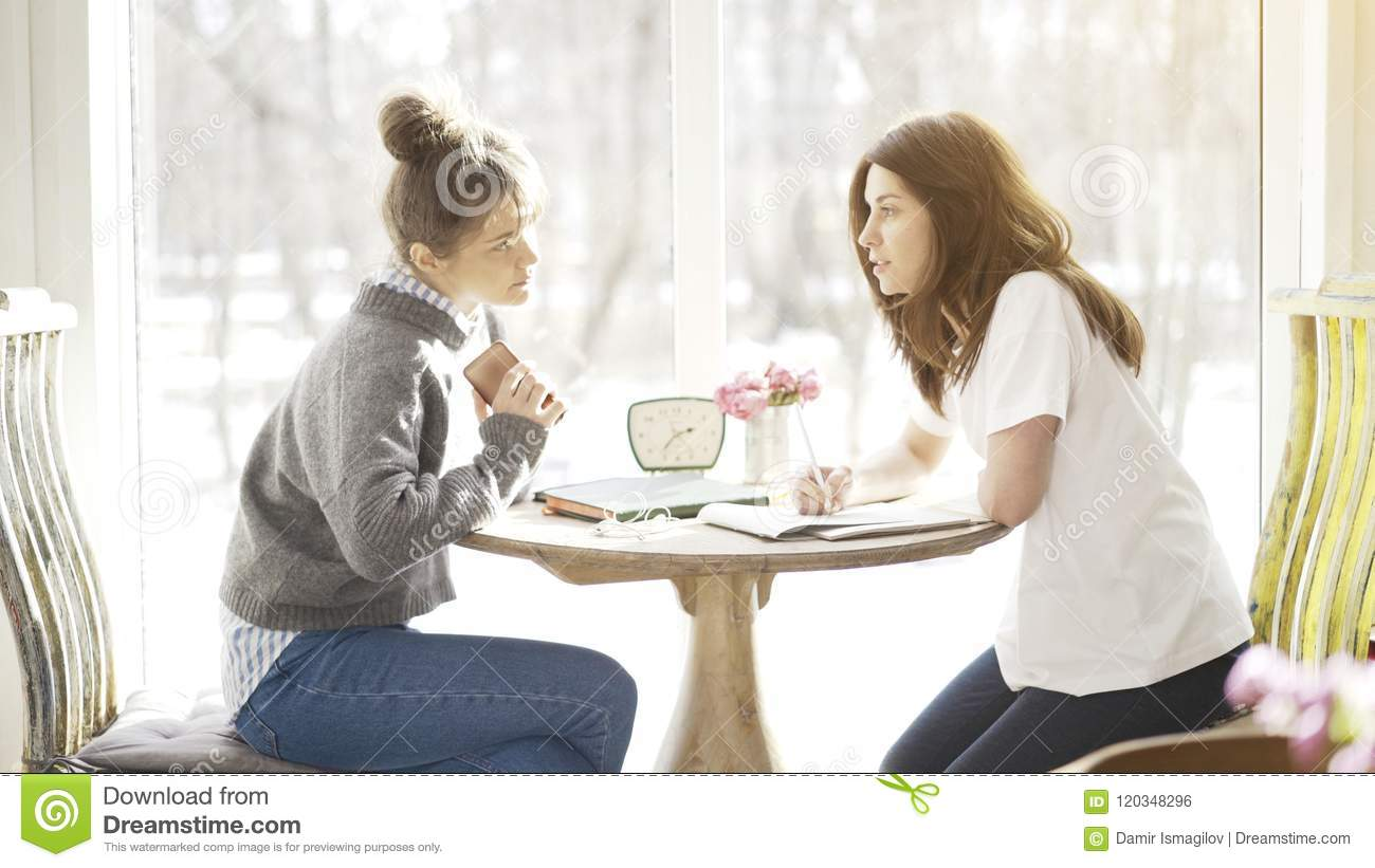 Two female friends students having a serious talk