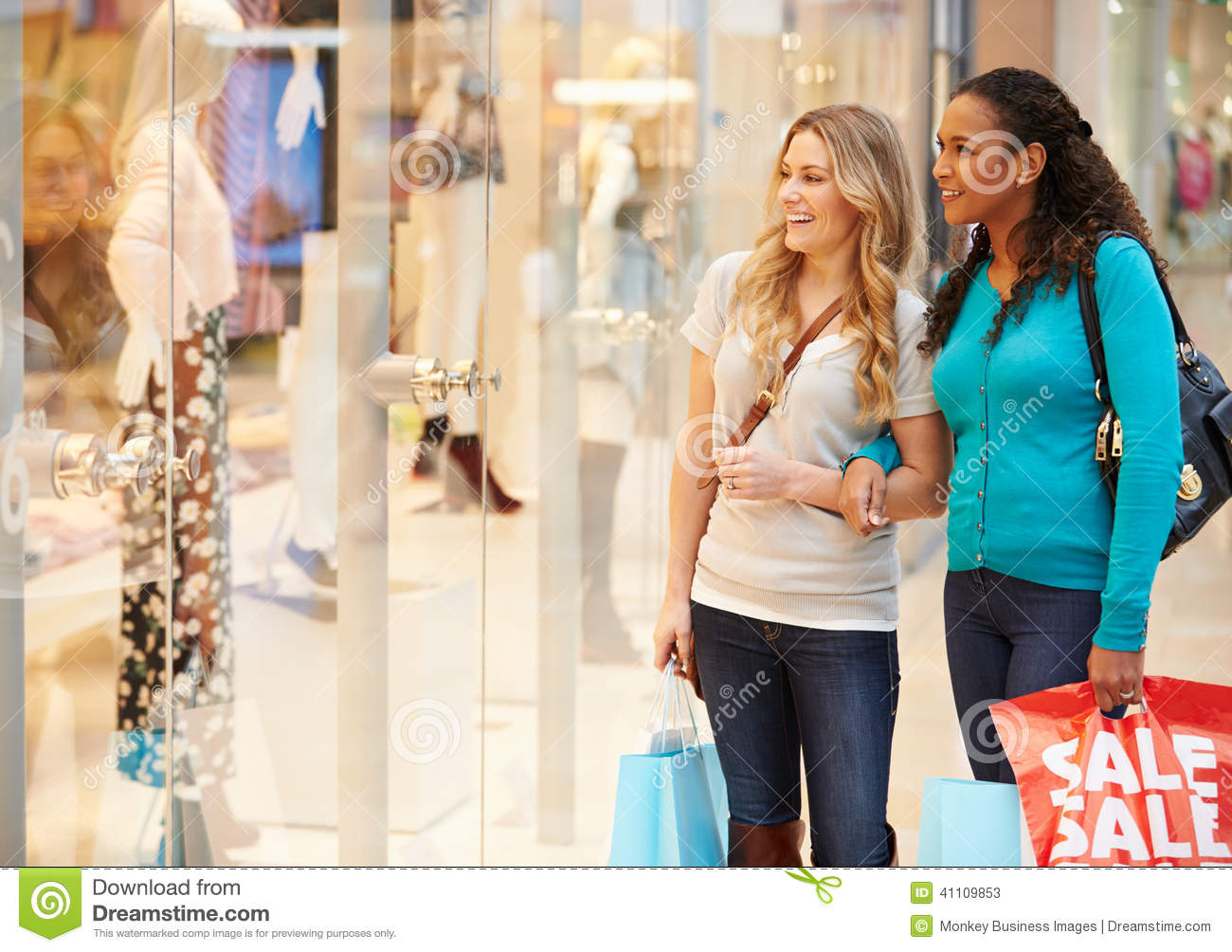 two female friends window shopping with bags stock image image of