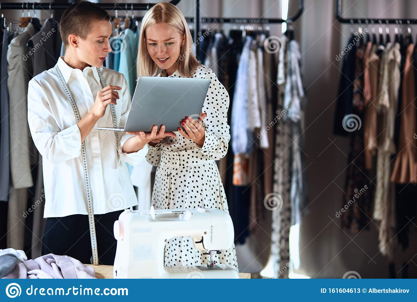 Two Female Looking On Laptop Model And Fashion Designer Stock Image Image Of Designer Fabric 161604613