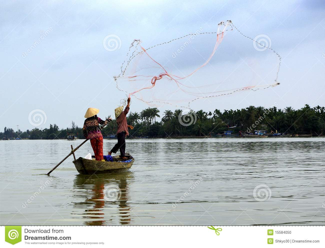 Download Two Fishermen In Action In A Little Boat Stock Photo - Image of fishermen, fishing: 15584050