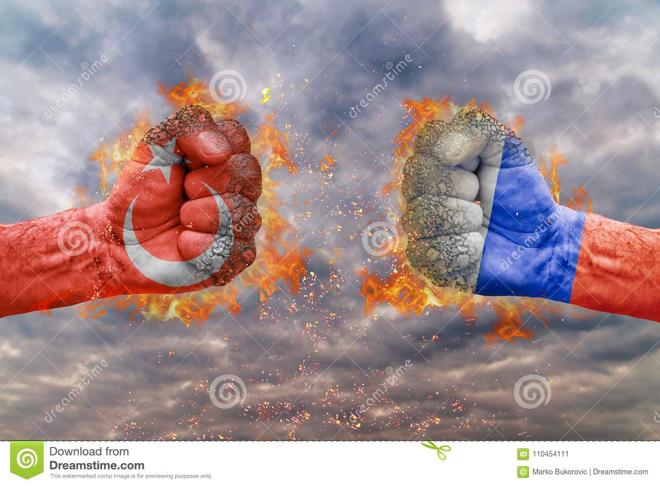 Two fist with the flag of Turkey and Russia faced at each other