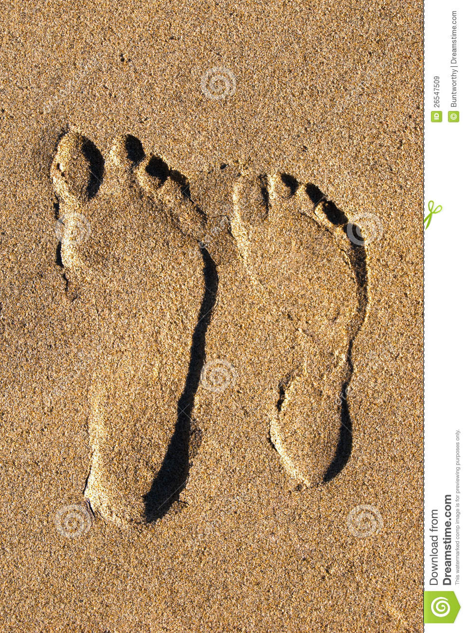 Two Footprints In The Sand From Above Stock Image Image