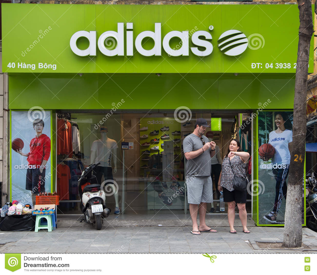 Inferior caravana combate  Two Foreign Customers Walk Out Of A Fashion Store Selling Adidas Products  Editorial Stock Image - Image of products, clothing: 70084404