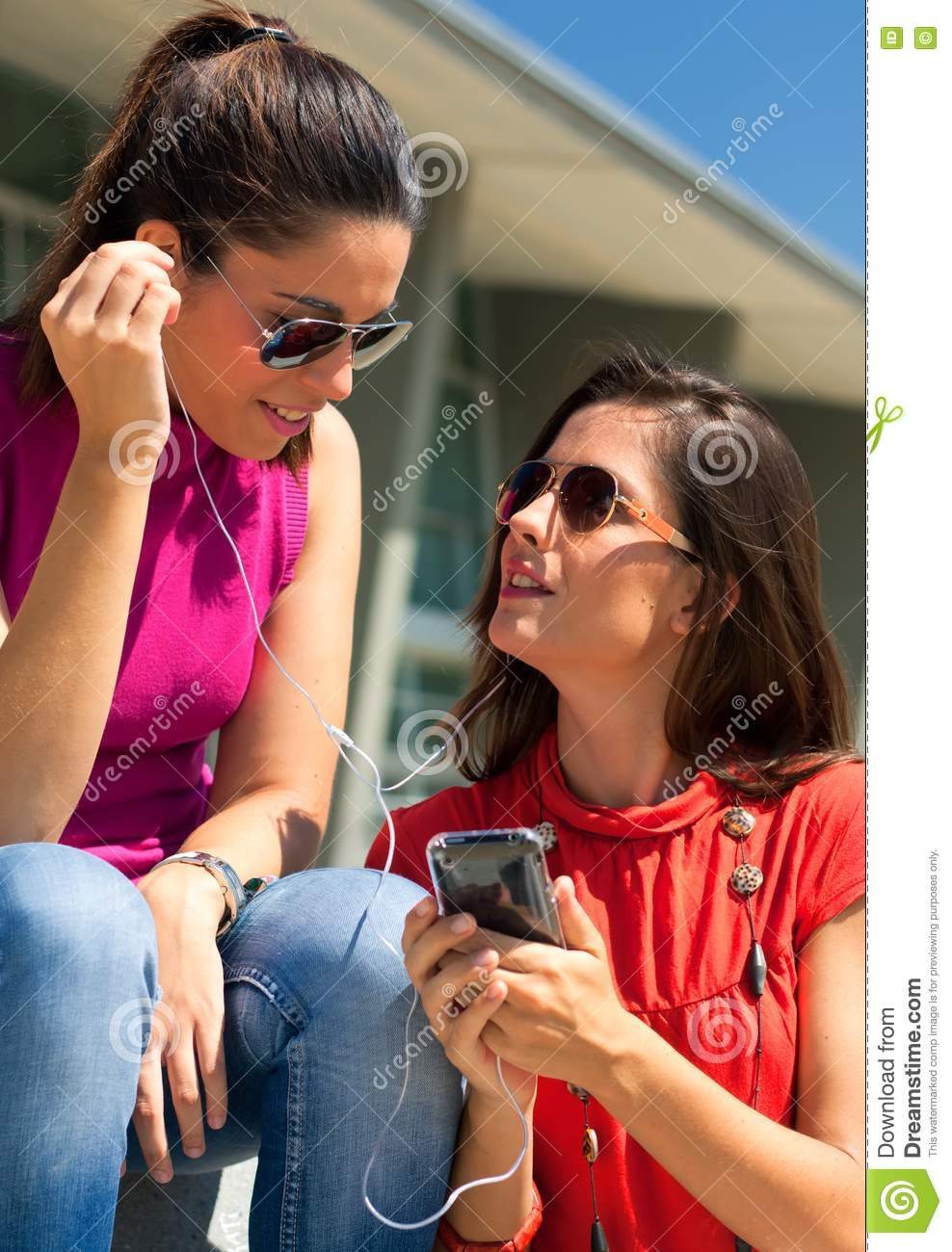 Two Friends Listening To Music Stock Photos - Image: 15898323