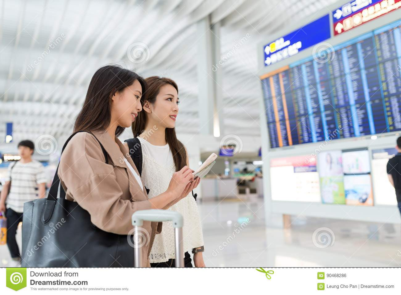 Two friends looking for flight number