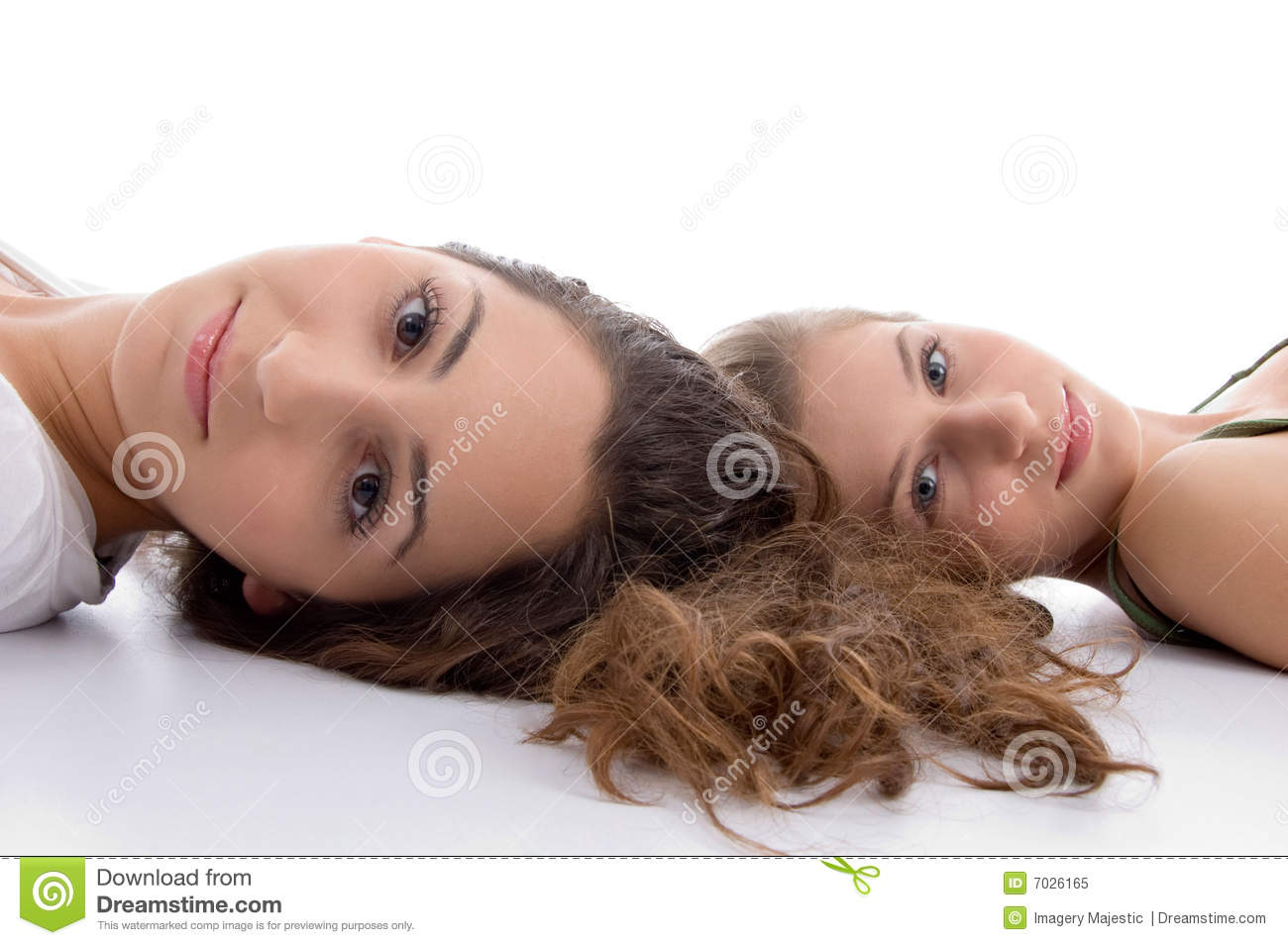 Two friends lying and looking at camera
