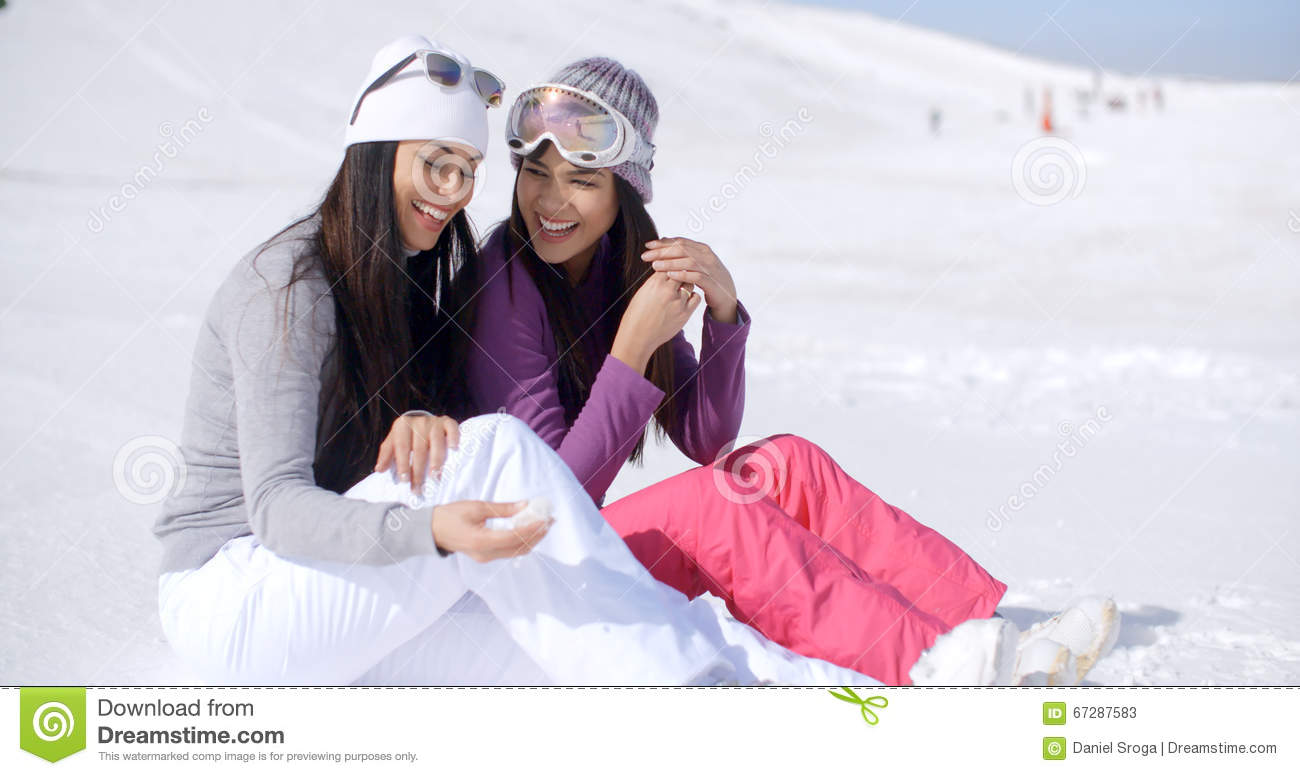 ab2dd8ff7f Two Friends Sitting Together On Sunny Ski Hill Stock Image - Image ...