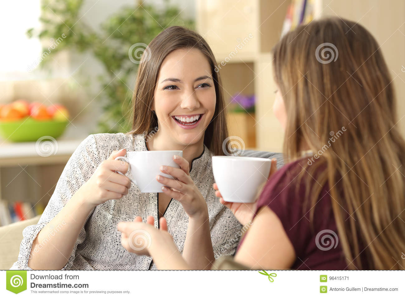 Two Friends Talking And Drinking At Home Stock Image - Image of
