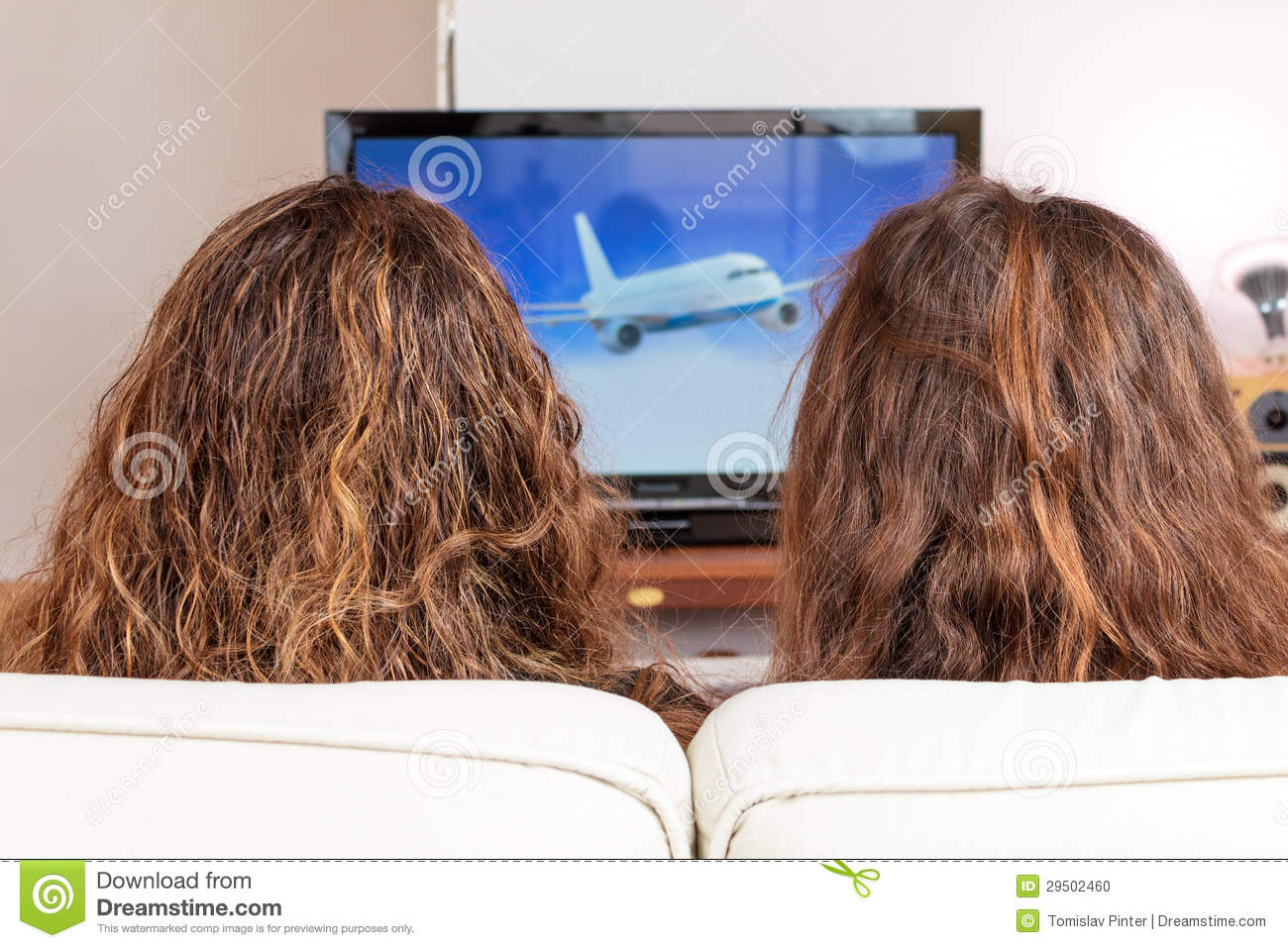Two friends watching TV