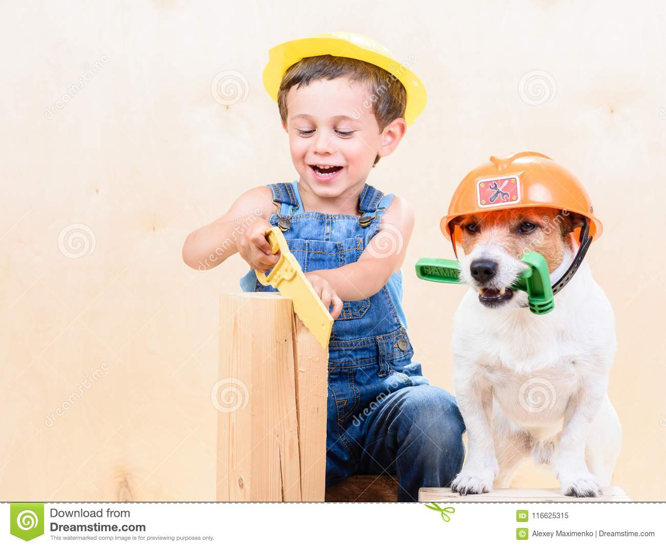 Kid And Dog Wearing Hardhats Working With Saw And Hammer At