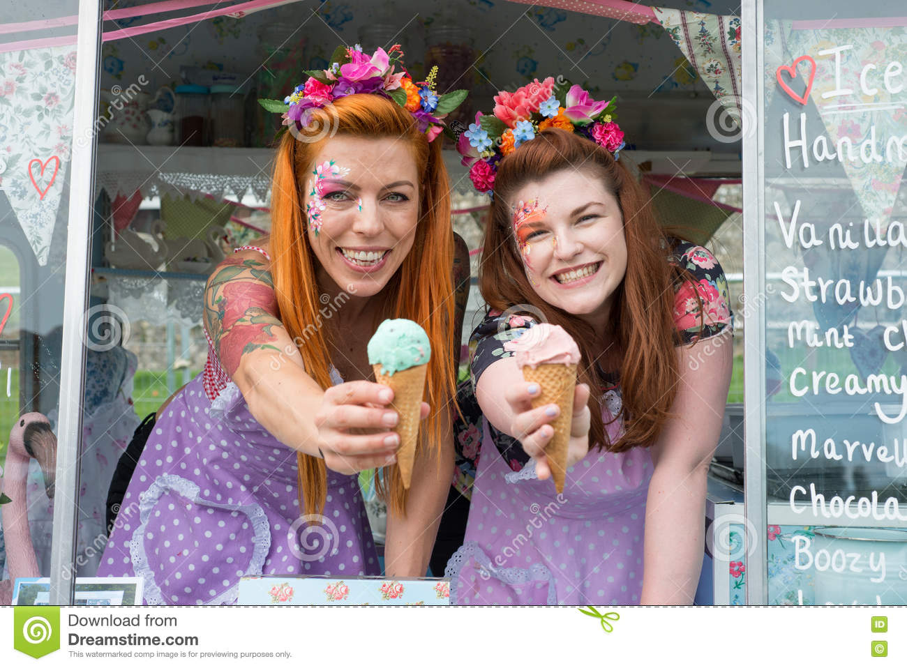 Two ginger haired ladies holding ice cream from truck