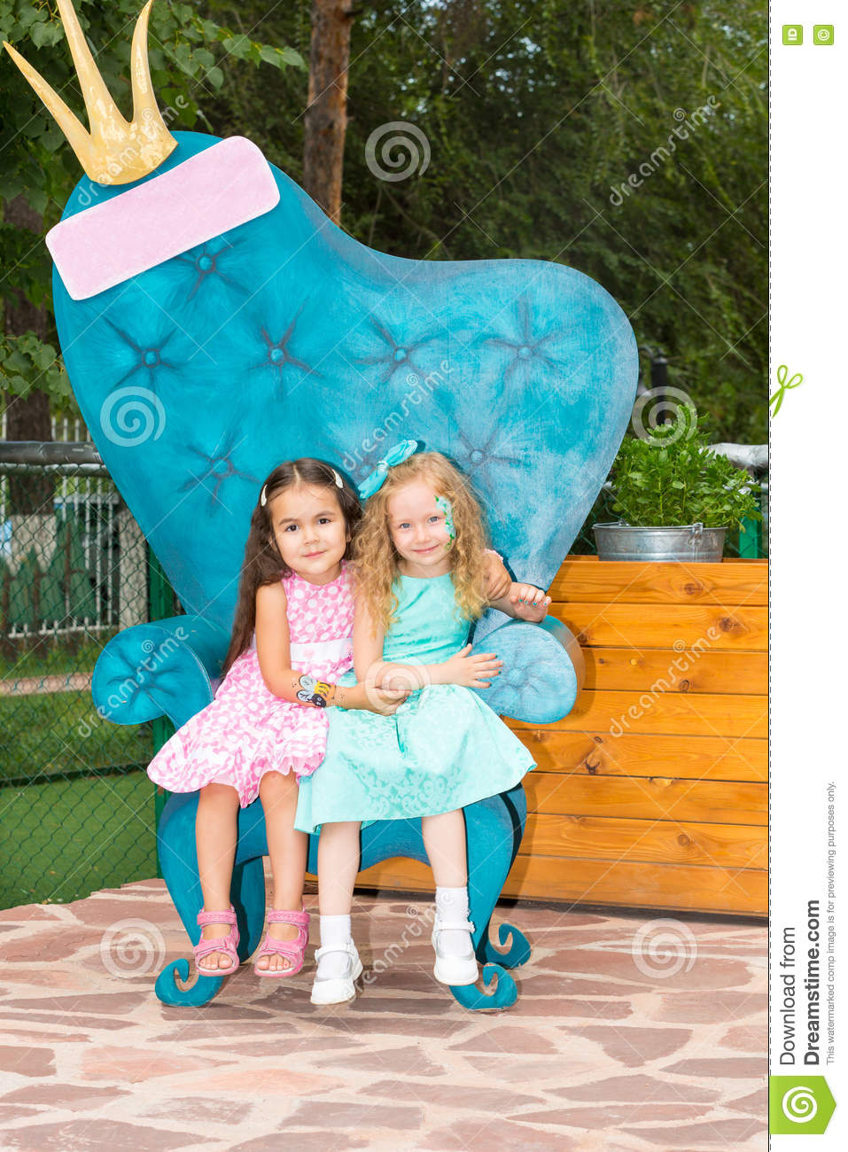 Two girlfriends. Adorable little children on happy birthday. Kid in park