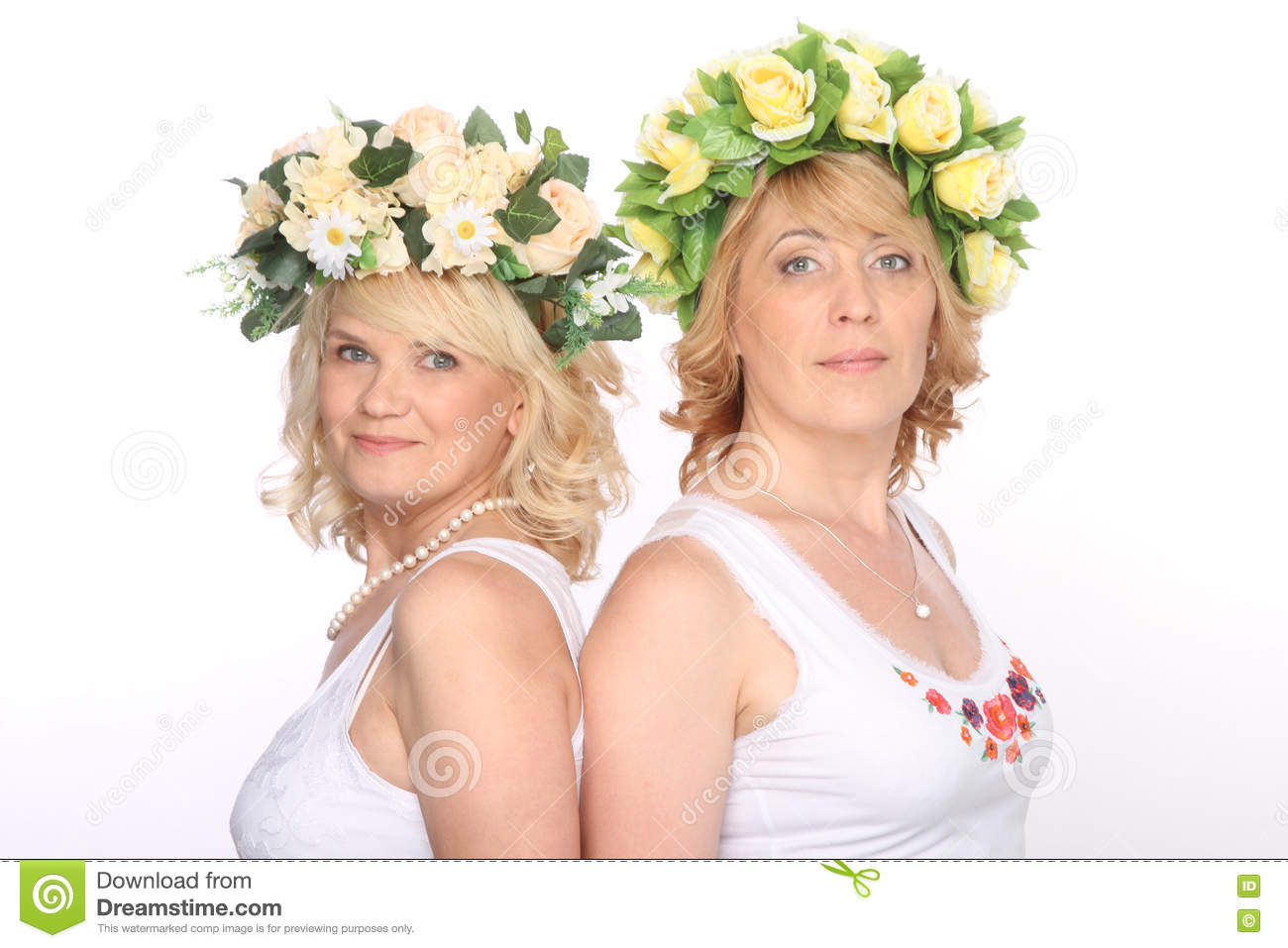 Two girlfriends blonde women in wreaths, smiling, standing backs