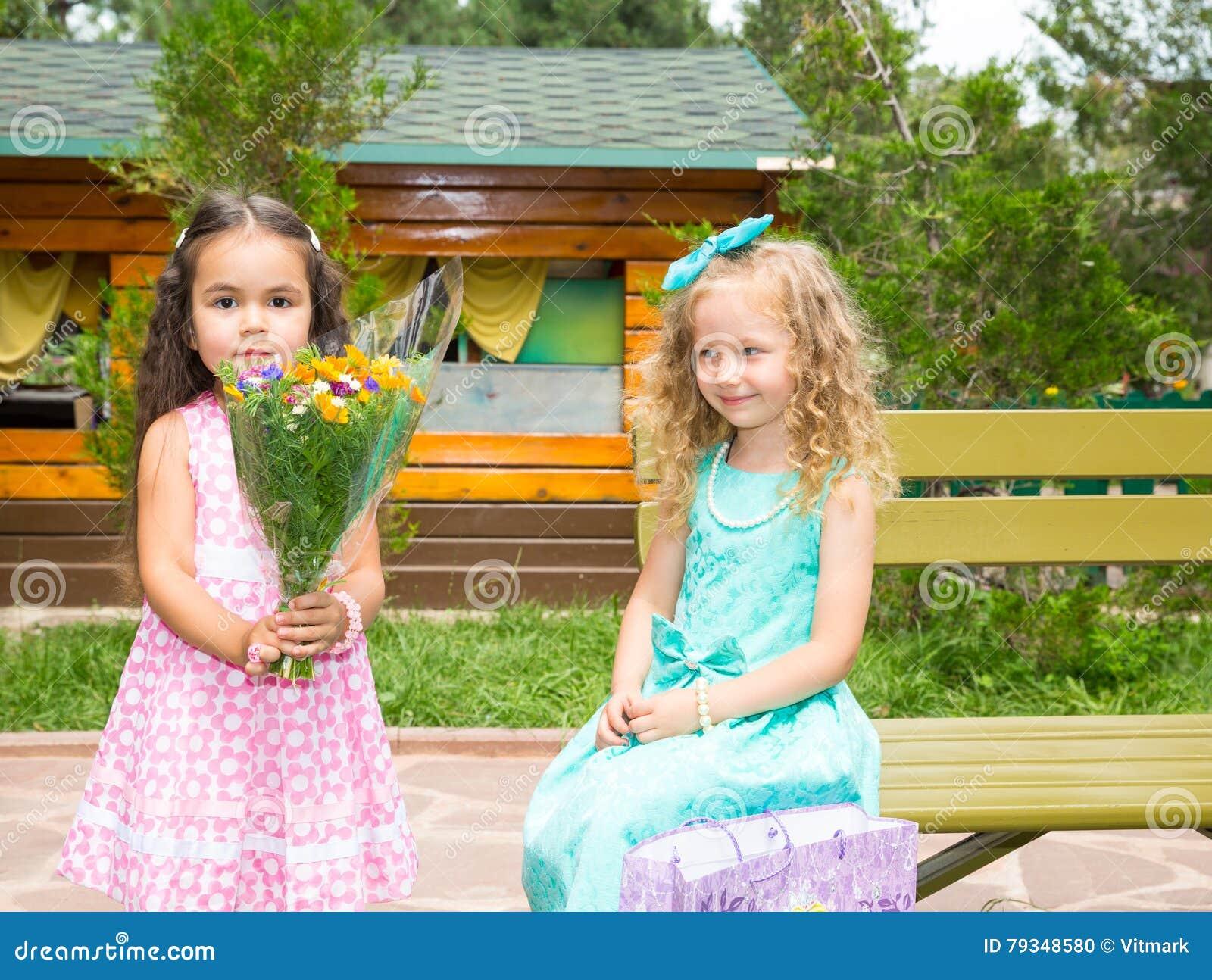 Two girlfriends. on happy birthday. Kid in park