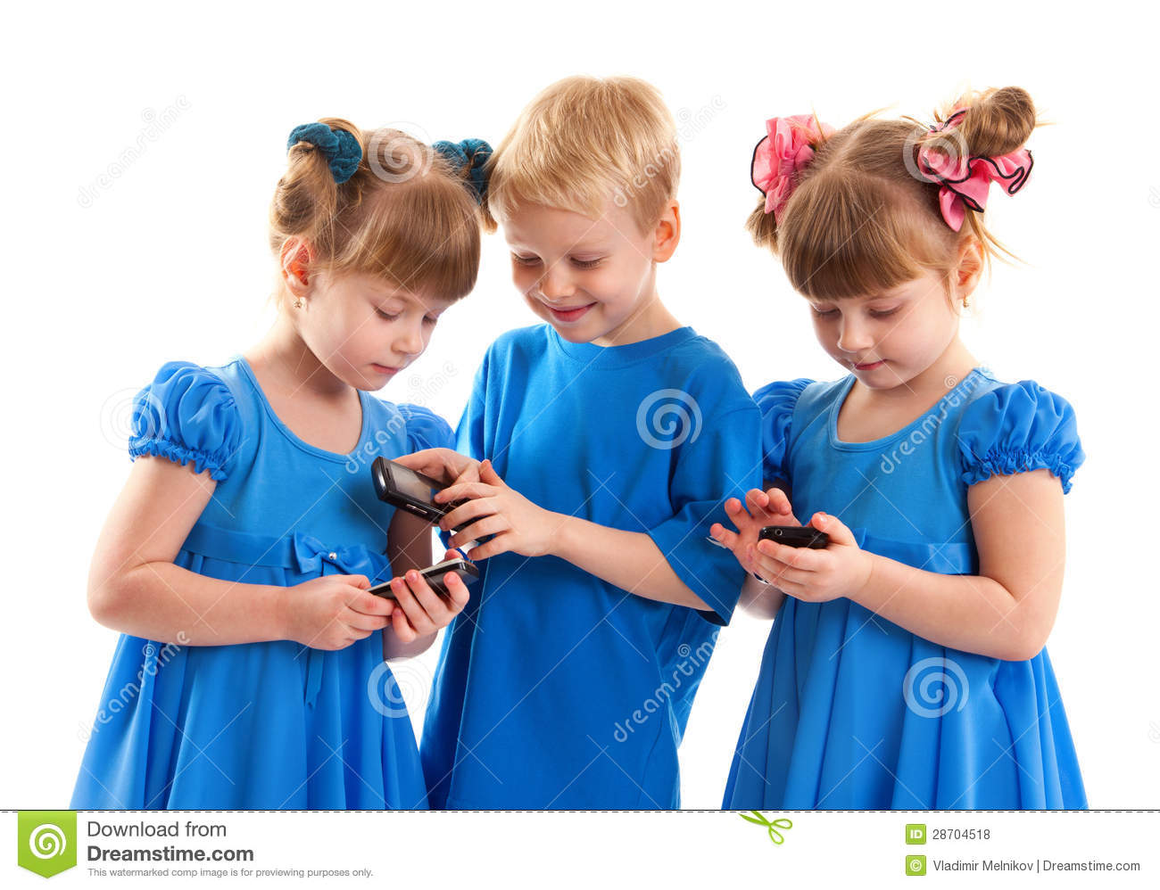 Two Girls And A Boy With Their Cell Phones Stock Photo