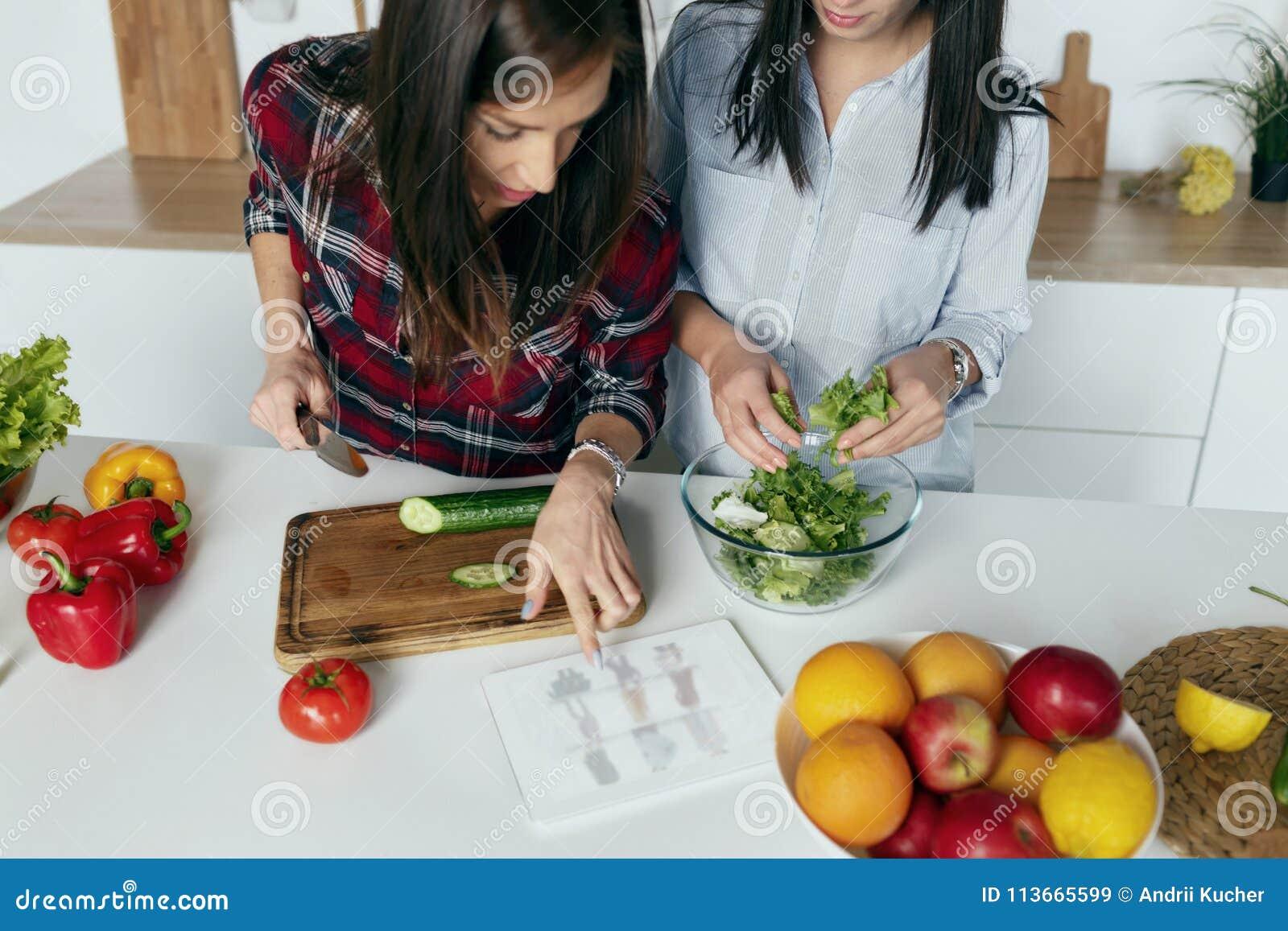 Two Girls Choosing Summer Dress Home Kitchen Online Shopping ...