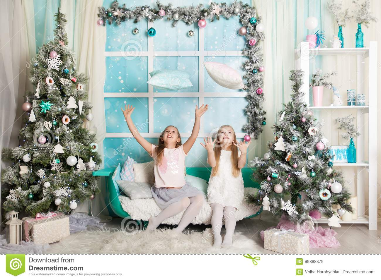 two girls in a christmas decorated studio in pastel colors