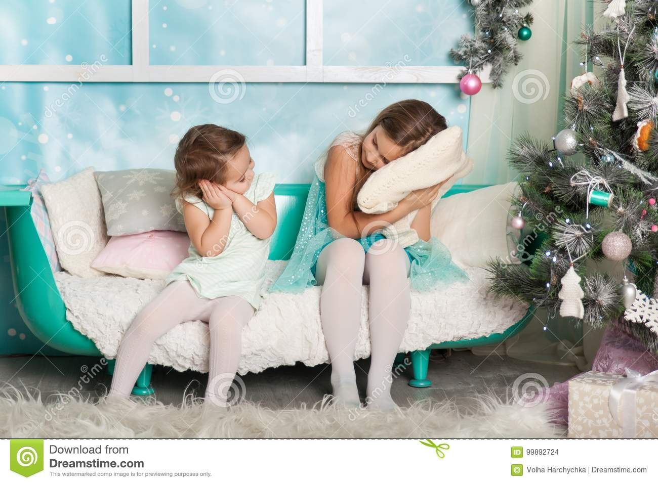 two girls in a christmas decorated studio in pastel colors - Pastel Christmas Decorations