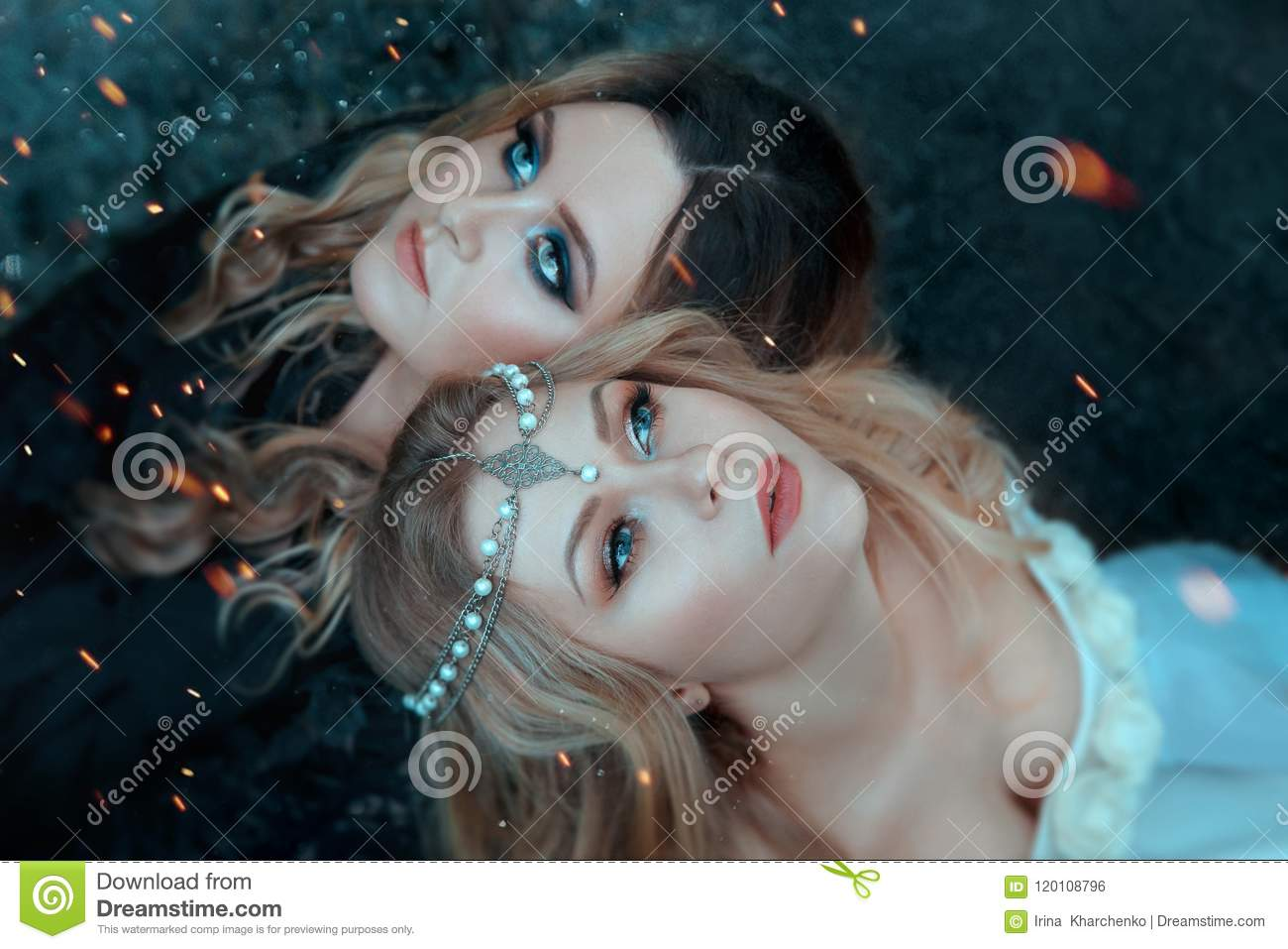 Two girls of the elements, opposites, love each other with affection. Around them, sparks, flashes of magic. Close-up